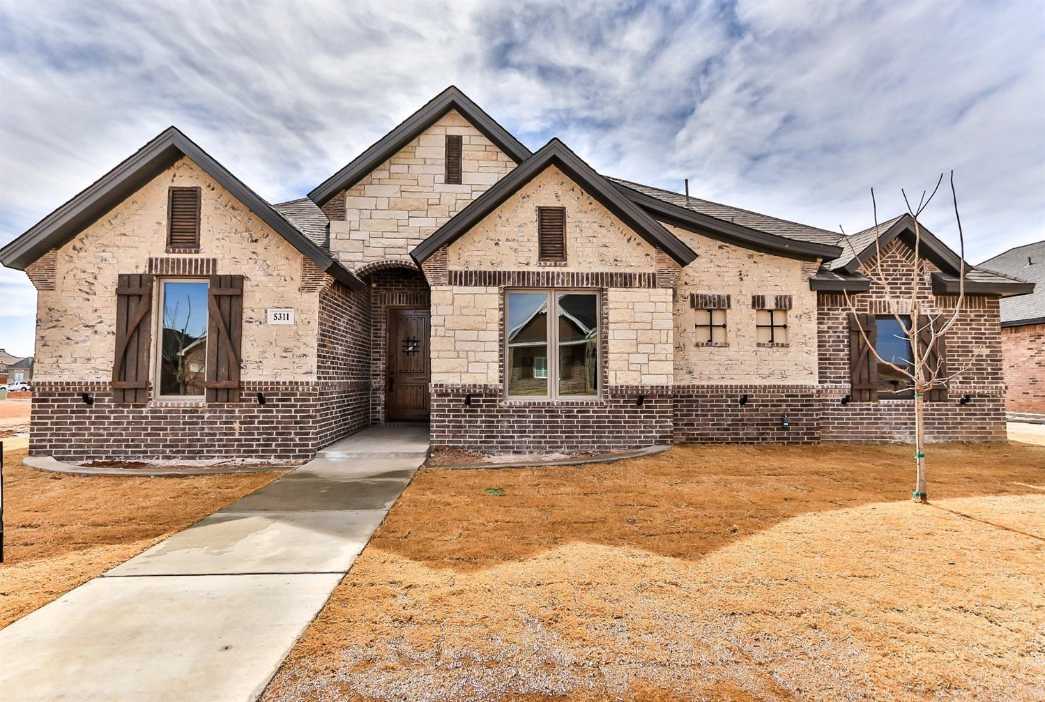 Quality construction and craftsmanship in this new home by HWH Builders. Open concept with breathtaking groin vaulted entry and soaring ceilings throughout. Kitchen features granite counters, large central island, gas stove and large pantry. Master has enormous walk in closet, double vanities, beautiful tile work and large shower.