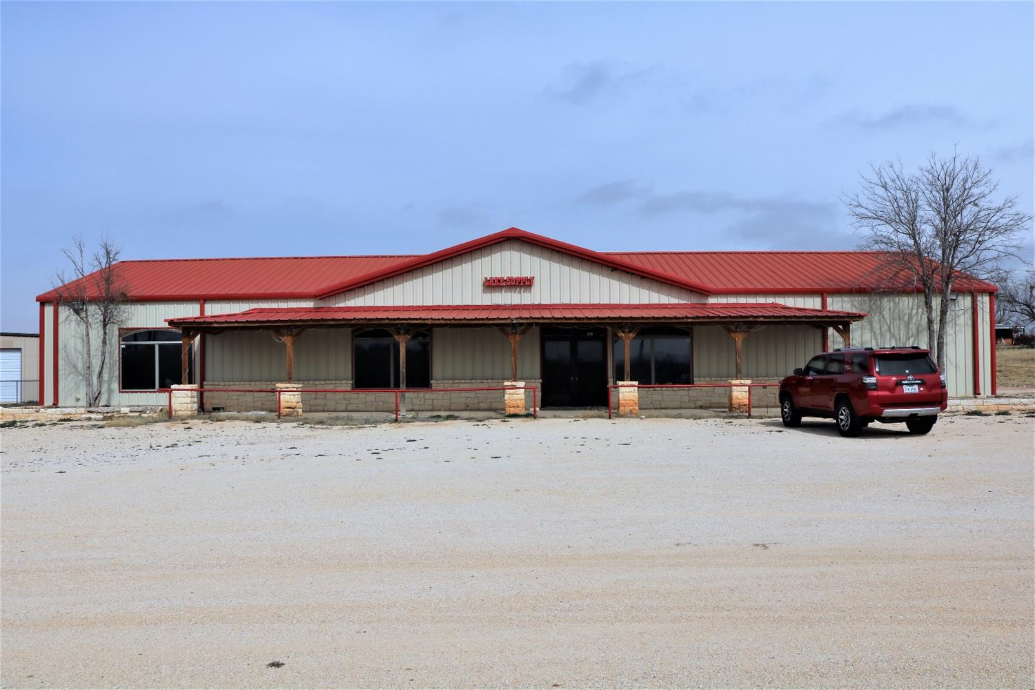 Lake Alan Henry supply store and former restaurant building is now available, situated on 4 acres. Located on the busiest street within the resort. This is a mixed use residential/commercial property. Neighboring subdivisions provide the perfect getaway from the big city to enjoy the outdoors with water sports, hiking, camping, and plenty of wildlife. Known for its abundance of Alabama Bass, Lake Alan Henry was named one of the best fishing lakes in Texas by Game and Fish Magazine in 2017. The main building is 40'x100', at 4,000 square feet with high ceilings and a free span interior design. The possibilities are endless. Barndominium, Man Cave, RV Park, Income Producing Potential. Boat Repair Service Center, In-door climate-controlled storage. This venue is wired with 3-Phase Electricity, Beverage Chases, and Separate restrooms. Utilities are in place for new construction throughout.