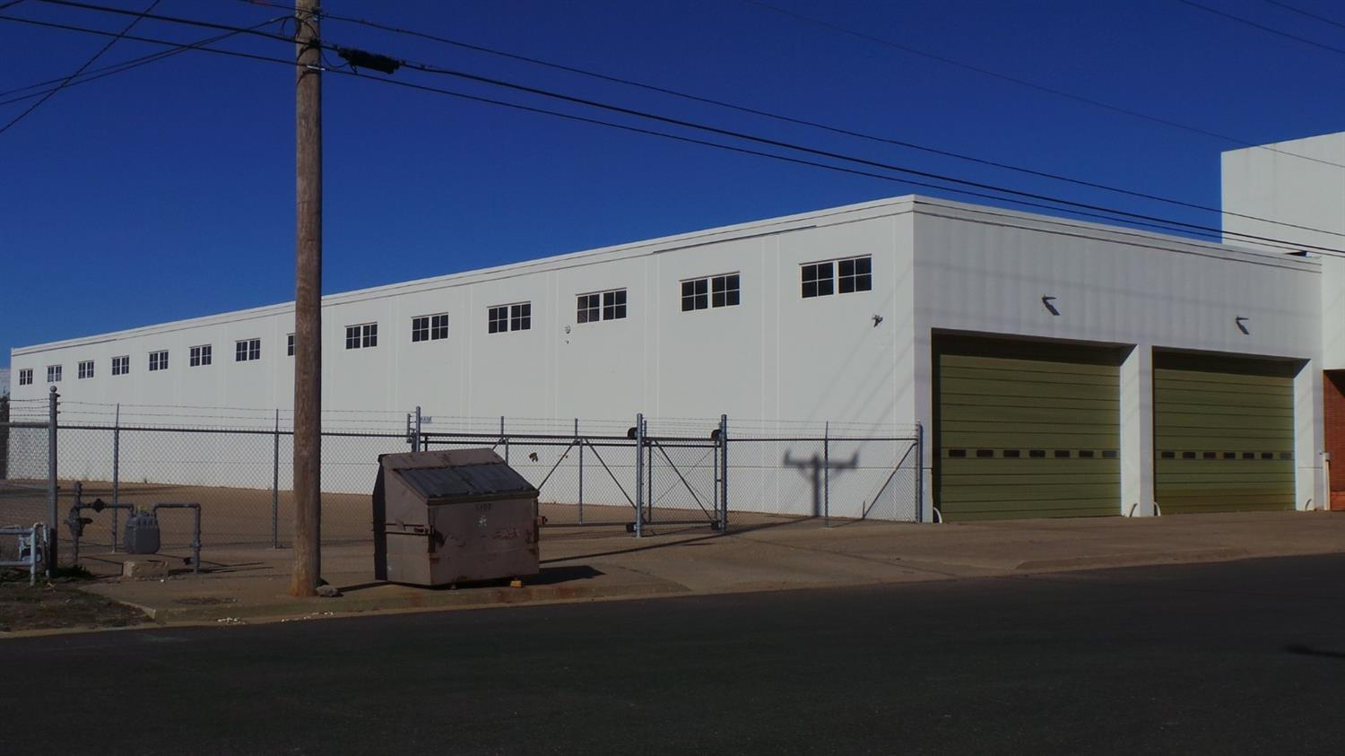 Outstanding 31,500 SF office / warehouse for sale with two indoor dock high doors. As of 2012, there has been a new roof added, new HVAC, all new security system and fenced parking / stack lot. This property is for sale or lease. Year Built: 1956  Remodeled: 2012; Entire Building is Dock High; Fire Sprinkler System; 4,000 SF Office Area; Open Concept, Modern Offices; Two Conference Rooms; 14' X 25' Overhead Doors; Secured Vault; 16' Ceiling Height