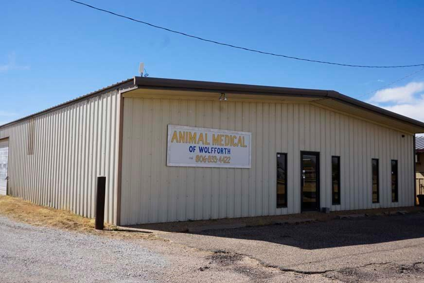 The main building is 6,000 SF with approximately 3,000 SF of office area that was formerly used as a veterinarian clinic. It features a large reception / waiting area with built in reception desk, three exam rooms, surgery room, x-ray/recovery room, kennel room with 12 kennels, three  restrooms, two offices, coffee bar, dog wash sink and quarantine room. The remainder of the building is warehouse space. There are additional metal storage buildings in the fenced area at the rear of the property. The building is on well and septic.