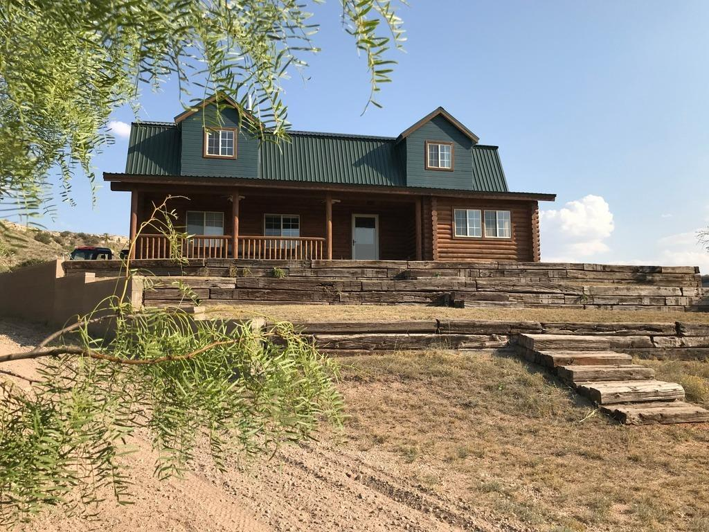 2-story Log home in beautiful Yellow House Canyon.  Magnificent views on 8.93 acres!!  All the warmth and charm of yesterday in this like new home.  It is outfitted with a horse barn, lighted riding arena and an additional open barn.  3 car garage and shop added recently. Even two Masters, one downstairs and one upstairs! Loaded with extras from finished basement/game room with safe room to the insulated attic. If you like a private park with beautiful setting and unmatched views, you have found it right here!  Once you see it you will want to own it.  Make showing appointment today!