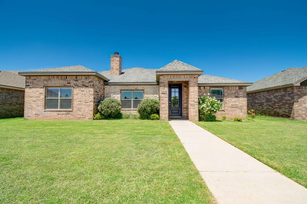 Gorgeous, gently lived in One Owner Home near hospitals and Texas Tech University! Great Curb Appeal featuring beautiful brick and stone. High Cathedral Ceiling with wood beam, fireplace with gas logs, vinyl plank floors, Open Floor Plan, Fabulous Kitchen with Granite, Subway Tile, Custom Cabinets, Upgraded Appliances, Mud Room with Storage and much, much more! Covered back patio, super back yard and rear entry garage. Must see to appreciate the custom touches throughout! TV does not convey, but bracket will. Alarm system and cameras do not convey either.