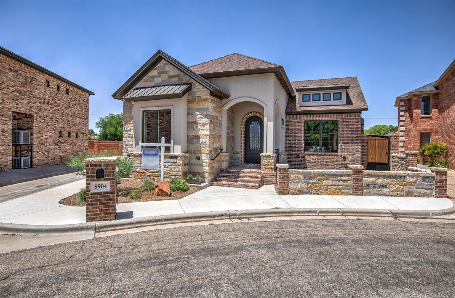 Tucked away in a serene cul-de-sac near the #6 hole of Lakeridge Country Club. The Fairways of Lakeridge Estates. Newly built 4/3/3 Larry Driskill garden home with open plan and low maintenance yard. Amenities are high-end and timeless. Dramatically beautiful stacked stone fireplace leads your eyes up to the vaulted ceiling. Breathtaking kitchen features: 5 burner gas cooktop, custom cabinetry, stunning granite, custom hood vent, double oven, and huge walnut island. Bright Pella windows flood this stunner with natural light. Incredible carpentry throughout! Exquisite back patio has outdoor kitchen and fireplace-perfect for entertaining & relaxing. Luxurious spa-like master suite has a safe room and dream closet. Garage provides one side that is tandem=opportunity for workshop or hobby car. 10 year new home warranty. ResNet Certified Home. ABUNDANCE of Energy Saving Features!