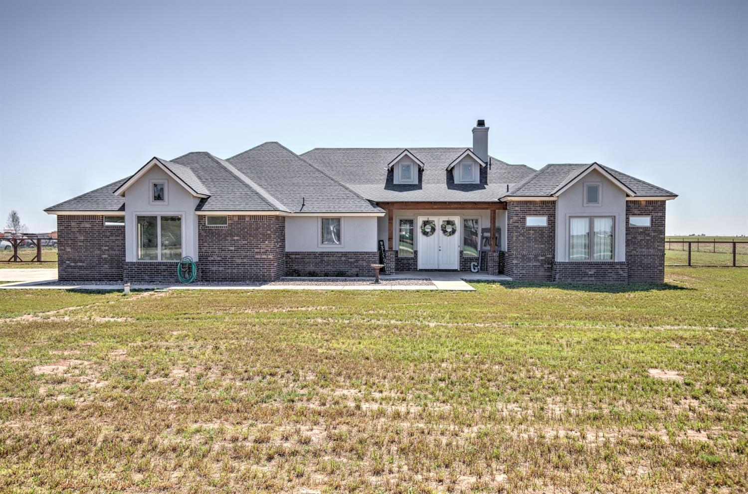 This beautiful home in New Home ISD, sits on 2.25 acres & features open concept, isolated master, granite counter tops, oversized garage, doggie shower, fenced, sprinkler system, & is pre wired for surround sound & security.  Perfect property for a couple horses.  Only fenced property in this development.