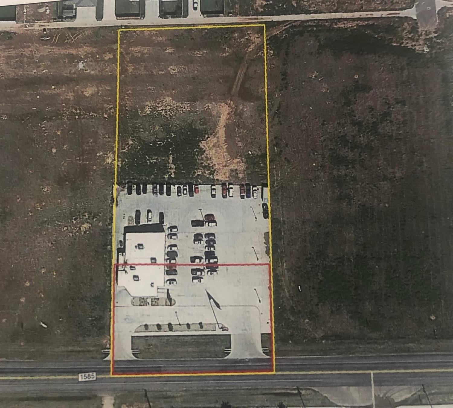 Land surrounding former Tech Cafe. Lot size after revision is 92,548 sq ft or 2.1246 acres. Vacant commercial land in location with future development on the horizon! Raw land, no improvements. Red outline on listing picture is what was taken via eminent domain...rest of area is what is for sale.