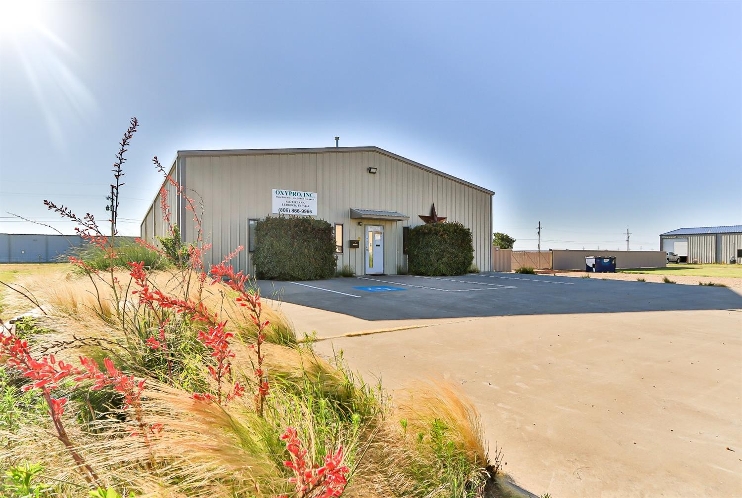 5,000 SF office/warehouse on fully fenced .934 acres for sale.  Includes 1,250 SF office and 3 separate warehouse bays.  Office includes reception, kitchen, 3 private offices, and an ADA restroom with a shower. There are three 14' overhead doors, and a 1,250 SF covered porch. Over-sized fenced lot with concrete paved parking lot. Loft decking above office and warehouses for extra storage.