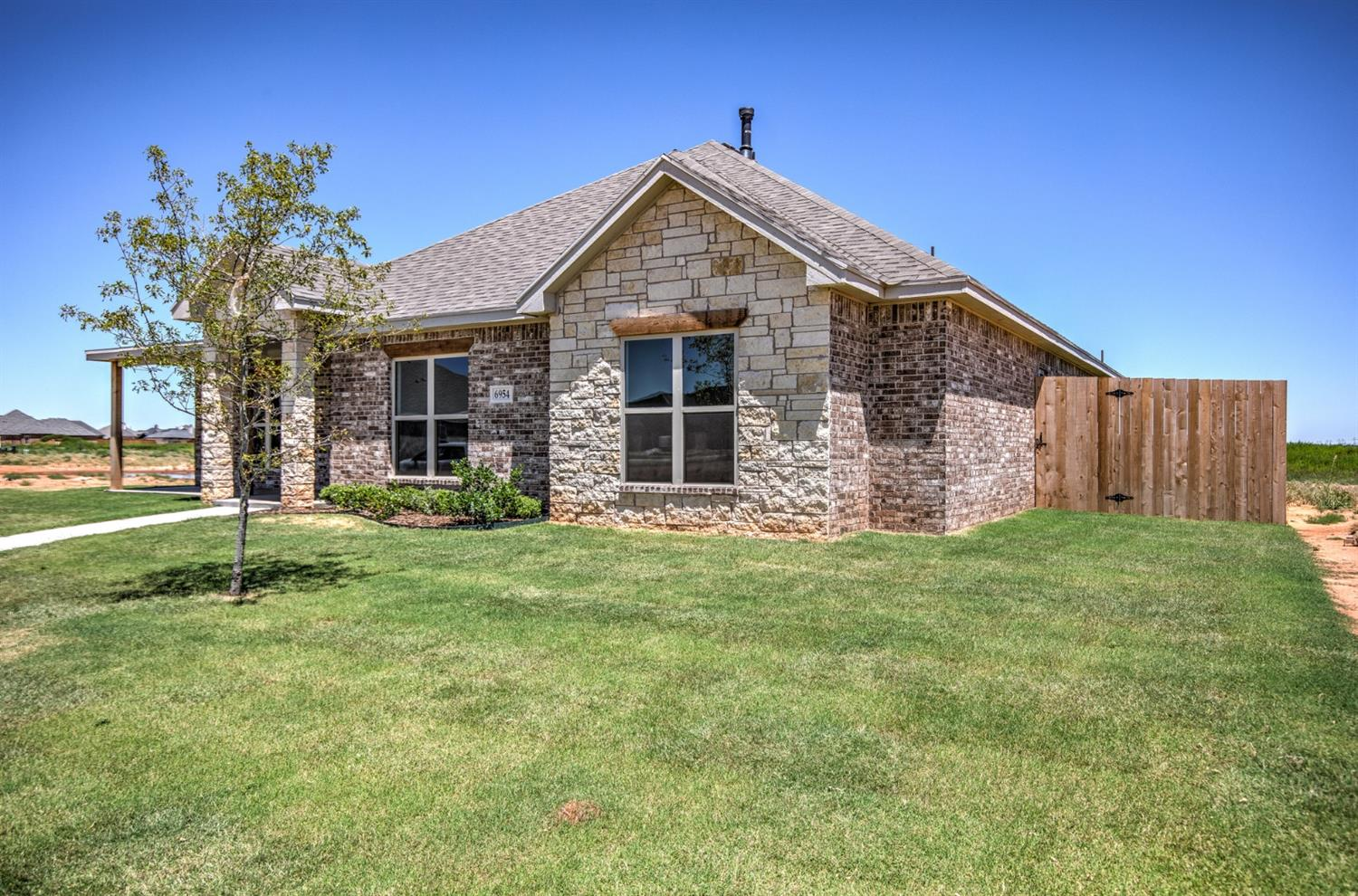 Custom Home located in the highly desired Frenship School District! Feel the luxury when walking into this well crafted home full of natural light, open concept and tons of storage. Gorgeous wood tile throughout with a stone fireplace and built in cabinets on either side. Fall in love with the gourmet kitchen boasting cabinets to ceiling, granite countertops, stainless steel appliances, large walk in panty, built in oven and gas range. Storage room that could be used as an office or as storage. Secluded large master suite with spa like master bathroom. 3 Spacious guest bedrooms with one bedroom having its own secluded bathroom, perfect for mother-in-law suite. Oversized garage and huge covered patio.