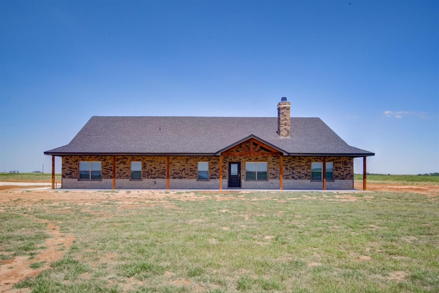 This gorgeous, brand new, open concept 4/3/2 home sits on just over 10 acres in the fabulous Idalou ISD. Features include tons of natural light everywhere you look, FaNtAsTiC kitchen w a butcher block island & great pantry, granite throughout the entire home, a stained beam that matches the mantle w cable connections & electrical outlets, 3 extra bedrooms that all have built-in shelves & 1 has a private bathroom, all 3 FULL bathrooms have double vanities plus it boasts an over-sized garage w a door to the huge covered back porch. The spacious isolated master & the master suite won't disappoint, wrap-around closet has built in shelves & a built in vanity. The 2nd family room or flex space features great lockers & the laundry room has a sink, tons of cabinets & counter space w an extra closet. BONUS: grass seed coming up, the house will be surrounded by lush green by winter! Make this your own peaceful country oasis today!!! Culvert on the way for the driveway!