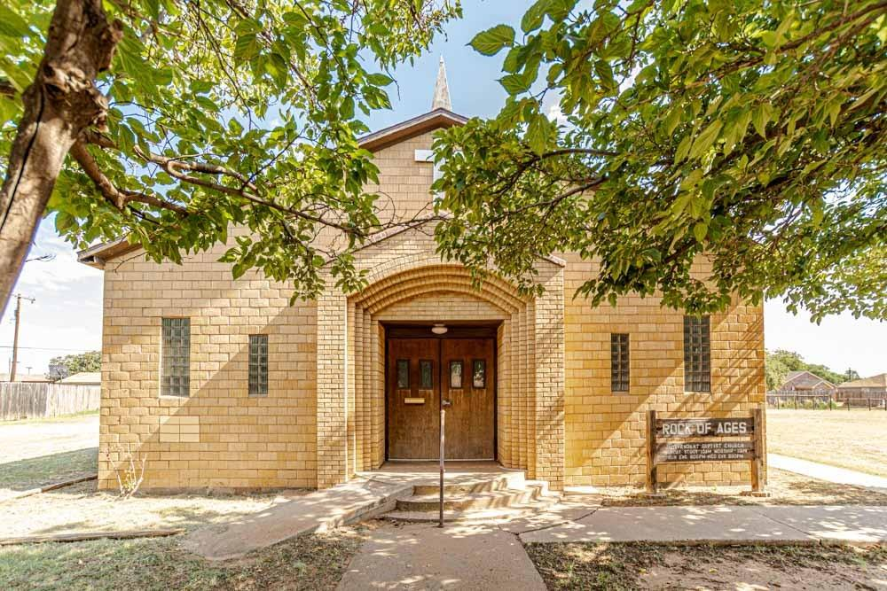 Fully furnished church building for sale. The building is approximately 2752 square feet on three lots. The property features a worship area, kitchen, fellowship hall and two restrooms.   Storage building! Lots of room to expand!