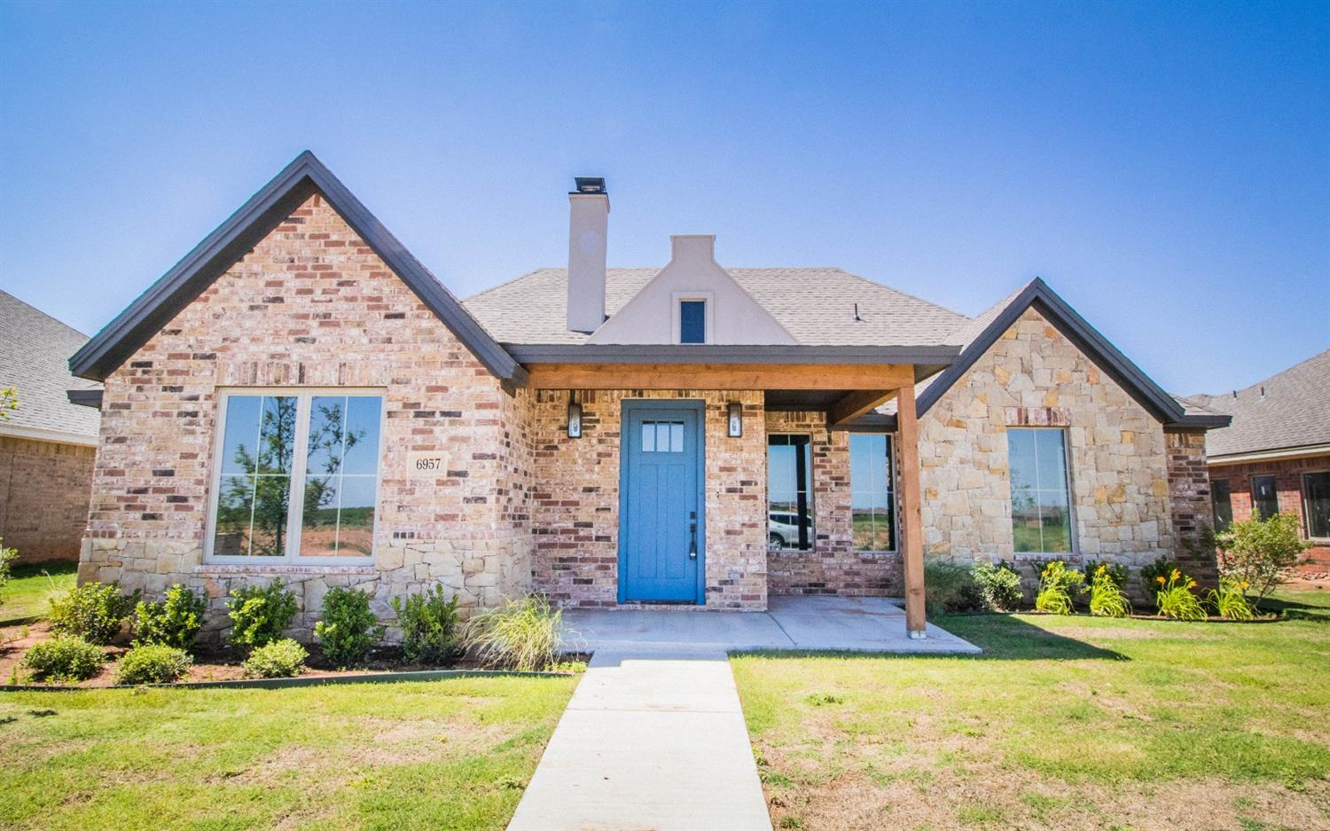 Cody Craig Custom Homes presents this 4/3/2 located in one of Lubbock's newest communities, The Ridge-located off 102nd Upland Ave. across the street from Frenship's Upland Heights elementary! This well designed floorplan offers an open concept living/kitchen with soaring ceilings, vinyl plank flooring, and a cozy gas fireplace. You'll swoon over this kitchen with a breakfast bar, granite countertops, beautiful range, and amazing fixtures and gorgeous lighting. The Master is a true retreat featuring double sinks, a free standing tub, beautifully tiled shower, re-circulating hot water, and a fabulous closet. The additional bedrooms boast vaulted ceilings with ceiling fans and are ideal for the growing family or guests. Other amenities include a mudroom area, desk and sprinkler system in front and back! This home is ready for a NEW OWNER!