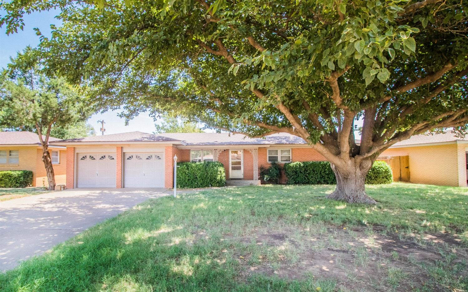 Check out this Amazing Home in Slaton!!! This 3/2/2 is on a great wide street, large front and backyard, and good size rooms. Carpet in rooms except for kitchen, bathrooms and laundry room. HARDWOOD floors are beneath the carpet. Call Liz today to see this great home. 806-632-5666