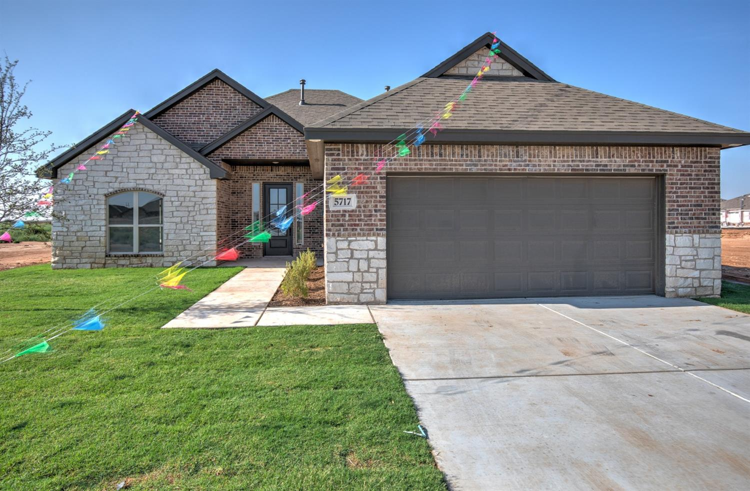 Located in Lubbock-Cooper ISD. Walking into this well designed open concept home you will be greeted with soaring 12' ceilings in the living room, luxurious wood tile, and gas fireplace. The chefs kitchen features cabinets to the ceiling with LED lighting, large window above your sink, stainless steel appliances, gas stove, large walk in pantry and a large island perfect for entertaining. Large isolated master suite with separate sinks, spacious walk in closet and separate tub and shower. The guest bedrooms are oversized with a jack n jill bathroom, as well as a second master in the back with its own bathroom, perfect for a mother in law suite! Large covered patio perfect for nice summer nights. Call today to schedule your showing, this home won't last long!