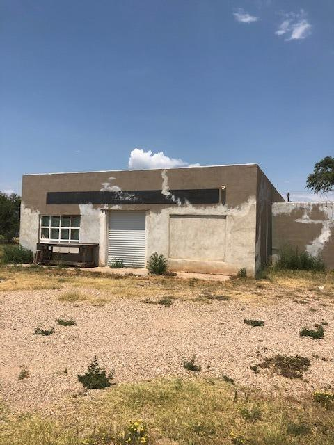 This Property includes a Machine shop,936 Sq. Ft house,and 1,632 Sq.Ft separate house, SELLS AS IS
