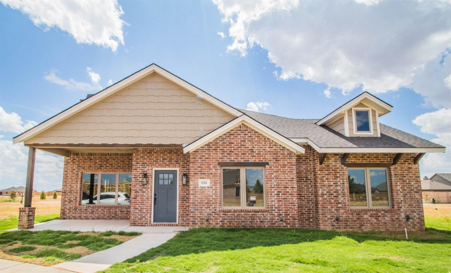 This delightful MCR property features a gorgeous brick and stone outer, soaring ceilings, and exquisite lighting features. Small details are what make a home, so come witness the beautiful granite countertops and tasteful color combinations! And don't forget the shaded porch, perfect for warm summer nights.