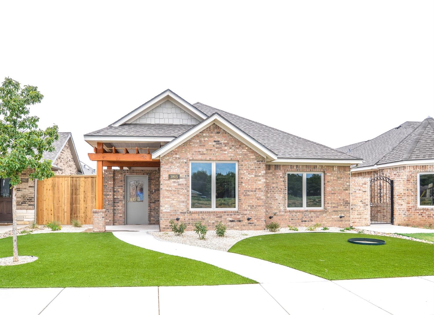 Fabulous new construction garden home built by Ron Reeves.  This home is located in Memphis Gardens, a new development which is surrounded by the mature and gorgeous neighborhood of Melonie Park. The open concept floor plan boasts beautiful vinyl plank flooring which runs throughout the entry, living room and kitchen. The kitchen has beautiful custom cabinetry, stainless steel appliances, an over-sized island and a large pantry. Large windows overlooking the patio area allow natural light to pour into the living, dining and kitchen area. The isolated master suite has a large walk in shower, double vanities, separate soaking tub and a large walk-in closet with loads of storage and built ins. This home has a fabulous covered patio, maintenance free landscaping and an amazing artificial turf front yard! The secure patio door has a ring doorbell which allows the owner to see who is at the door and allow access. Schedule your private showing of this beautiful Ron Reeves home today!