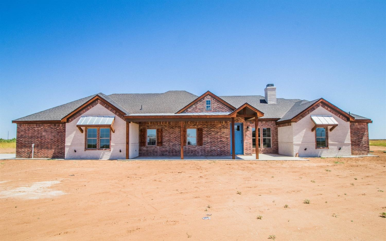 New construction, rustic contemporary home on 2.25 acres in New Home ISD.  One of Abounding Building Traditions premier customized homes features an appealing walk-out ranch front porch.  For pet or show animal owners or even outdoor working, there is a garage shower area just for you!  The interior features a farm-style stainless sink, double ovens, built-in impressive capacity refrigerator & granite counter-tops throughout.  The walk-in gourmet pantry covers approximately 70 sq ft featuring ample lighting with it's own window.  The kitchen table-esque bar comfortably seats 4-6, dining room vinyl plank herringbone design.  Modern unique tile designs throughout.  You'll enjoy the wide open spaces from the inside out!