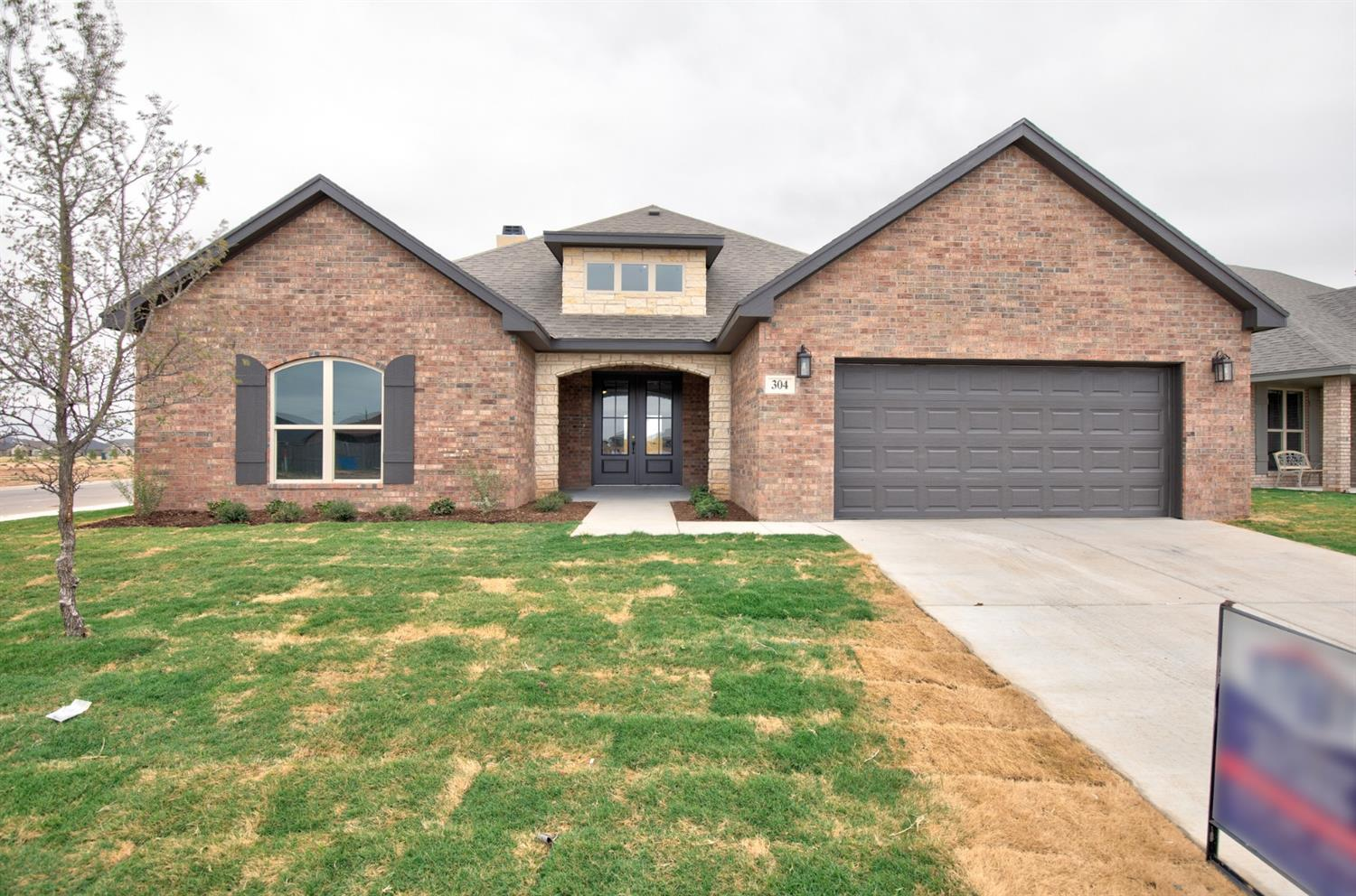 Welcome Home! Walking into this well designed open concept floor plan you will be greeted with a large open living area boasting a large rocked fireplace, luxury wood tile flooring, tall ceilings throughout and tons of natural light. The chefs kitchen features tons of cabinet space, granite countertops, and a  large island great for entertaining! The isolated master suite features a large walk in shower, soaking tub and a spacious closet! Outside you will find a large covered patio perfect for those summer nights! There is still time to customize it to your style!