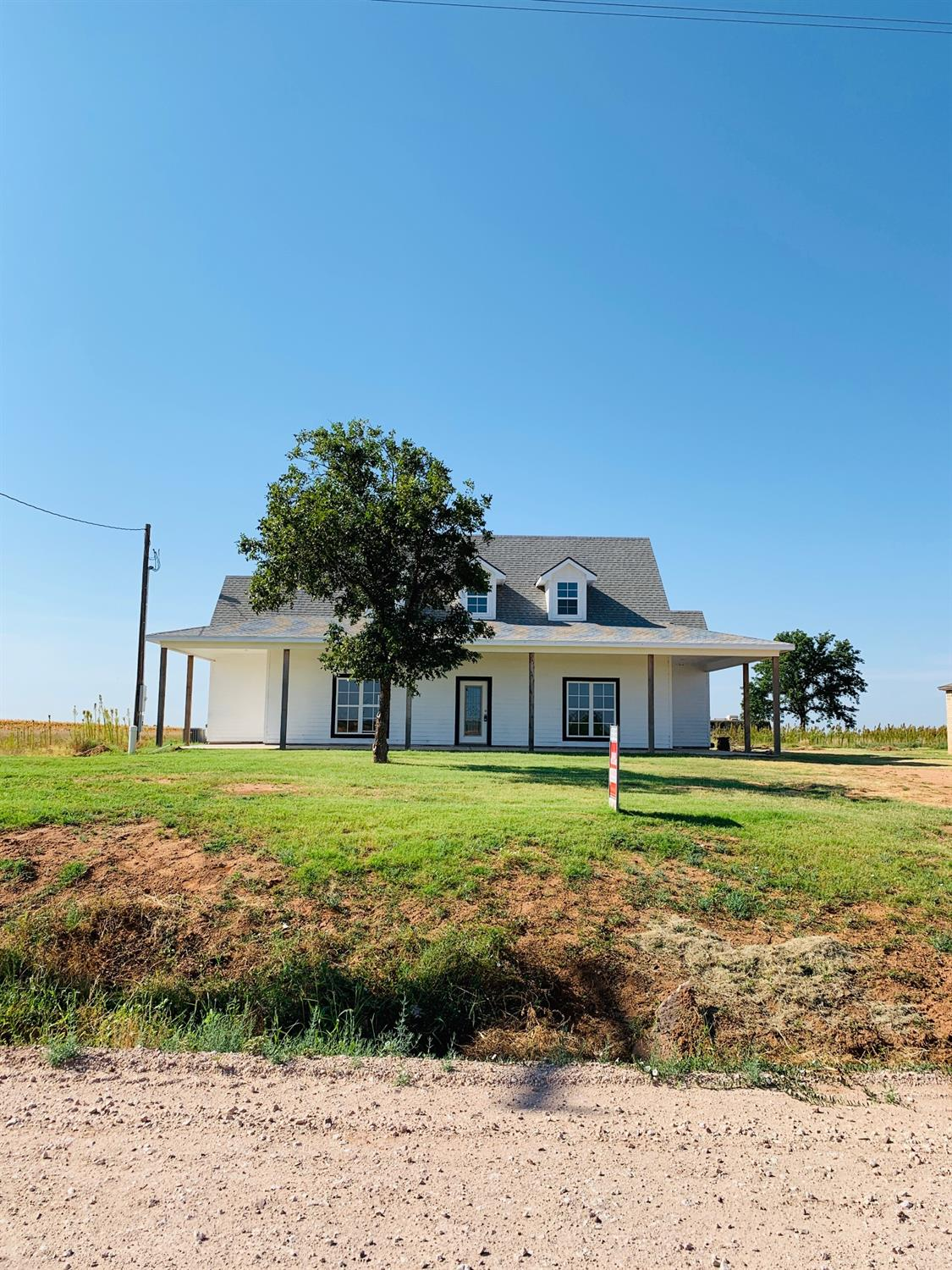 Country Living!  Brand New Farm House Located at New Home! New Home ISD and just a few minutes from school.  Home sits on 3/4 of a acre.  You will fall in love with this home from the second you drive up.  Two Story Farm House with wrap around Porch on Front, sides  and Great Back Porch.  Home is a 4/3 with 450 SF Basement. Basement has two separate rooms located for so many options.  Master Bedroom is located down stairs with a 2nd Master with full bath also down stairs.   Open Floor Plan to enjoy with family and friends. This kitchen is a cooks dream, gas stainless appliances, tons of cabinets to the ceiling and counter space. All rooms have beautiful windows to see great country view everywhere you look.  Two Bedrooms upstairs with full bathroom and a great workspace in hallway.