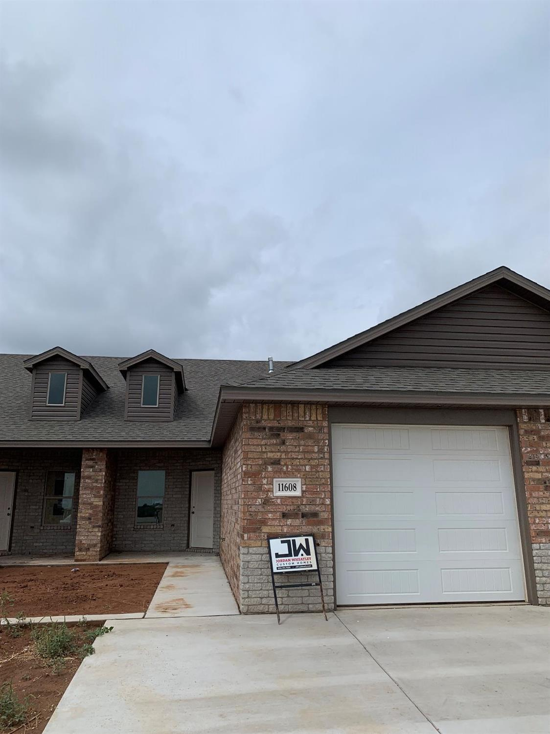 NEW CONSTRUCTION townhome by Jordan Wheatley Custom Homes.  Move-in ready 2/2/1. Tile floors everywhere except carpet in bedrooms. No vinyl plank. Granite countertops, designer lighting and Delta faucets.  Complete with metal fascia, xeriscape front yards,and artificial turf. Backyard fenced, sprinkler system and sod. These townhomes are perfect for anyone wanting to simplify their living or investment in SW Lubbock!