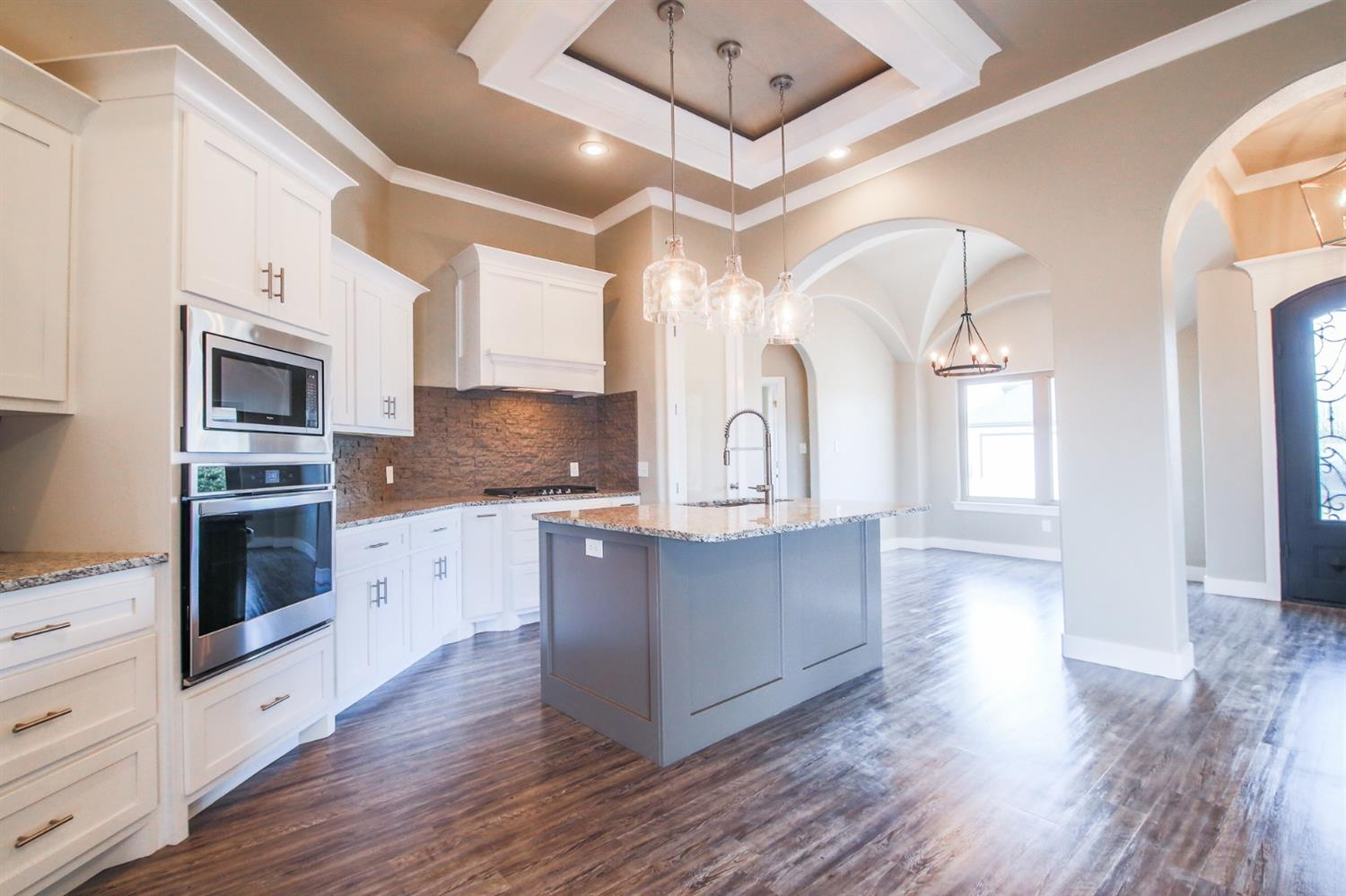 Beautiful 4/3/2 in Valencia! Exceptional amenities throughout: Iron Front Door, Special Ceiling details, Granite counters in kitchen and 3 baths, Isolated master retreat w/ Spa inspired en suite and a 2nd isolated master w/ private bath. The additional guest rooms share a hall bath and are adjacent to an office/ homework nook. You will love how this plan is follows the curves of the extra wide lot! Enjoy time with family and friends on the expansive back patio. Welcome Home!