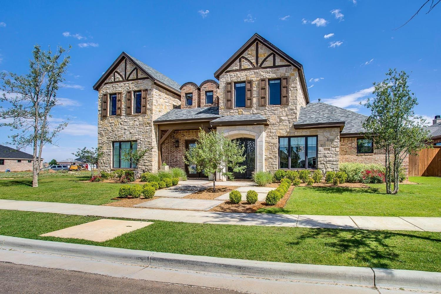 This stunning home in The Trails at Regal Park won Best Interior as a Parade Home in 2016. Beautiful curb appeal as you walk up to this brick and stone home with gorgeous cedar accents. Walk in to an open concept floor plan with light oak hardwood floors. The perfect amount of rustic touches throughout including repurposed barn wood used for the ceiling and an accent wall. The open living and kitchen area has beautiful natural  light with sliding doors that lead into this fabulous backyard. The oversized island makes the perfect gathering place. This home has all the space you need for a family with four bedrooms, three bathrooms, a formal dining room, study, and an upstairs bonus area that would make a great game or play room. Complete with a mud room, safe room, bug covered patio with built-in grill, garden area in corner or yard, and lots of entertaining space! Welcome home!!