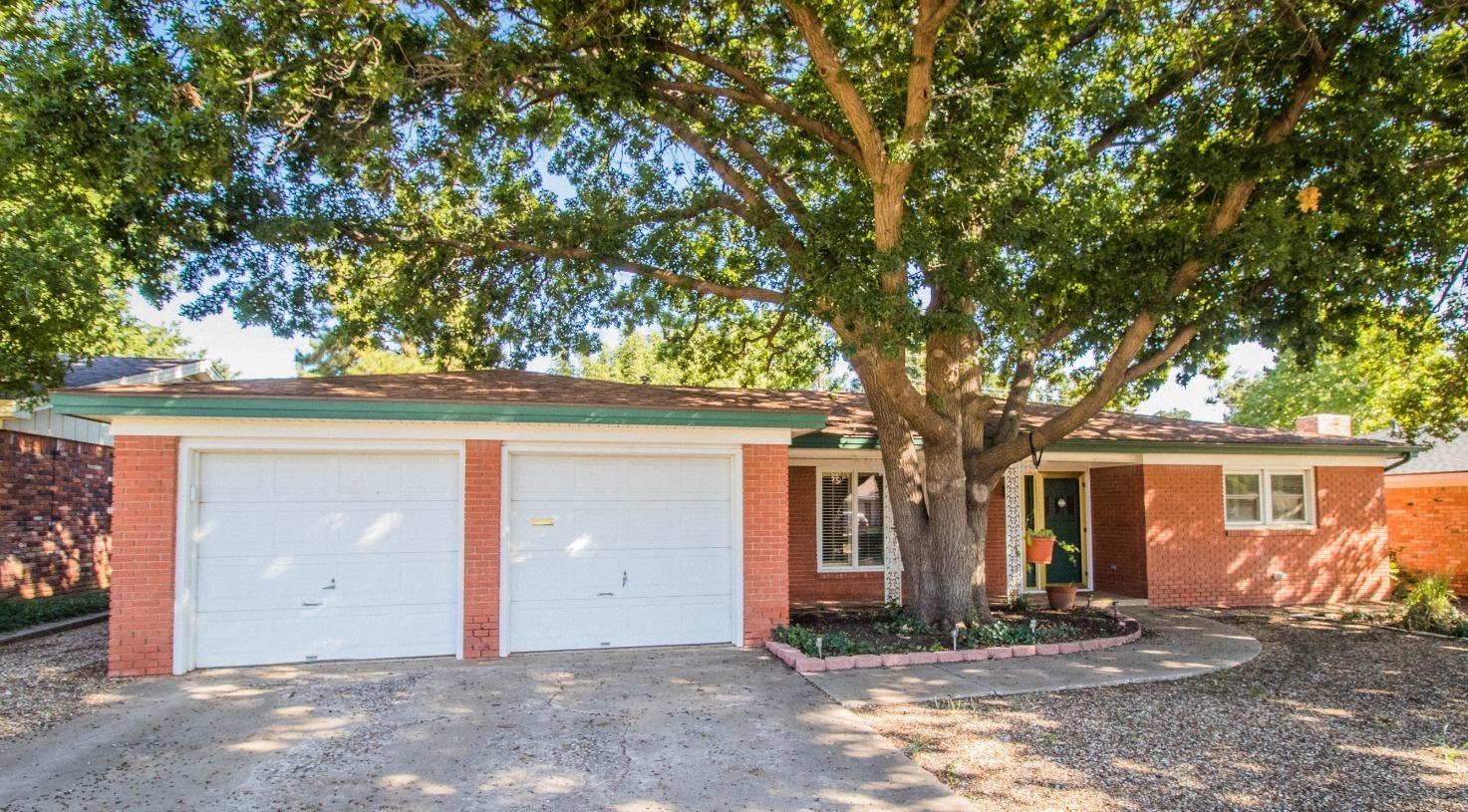 Check out this Amazing 3/2.5/2 home with basement and bricked shop in the back. This shop has a 2 car garage door on the back facing the alley with a 1/2 bath in it! This home has hardwood floors, quartz counter tops and so many more upgrades. You will enjoy the beautiful grown trees and landscape.