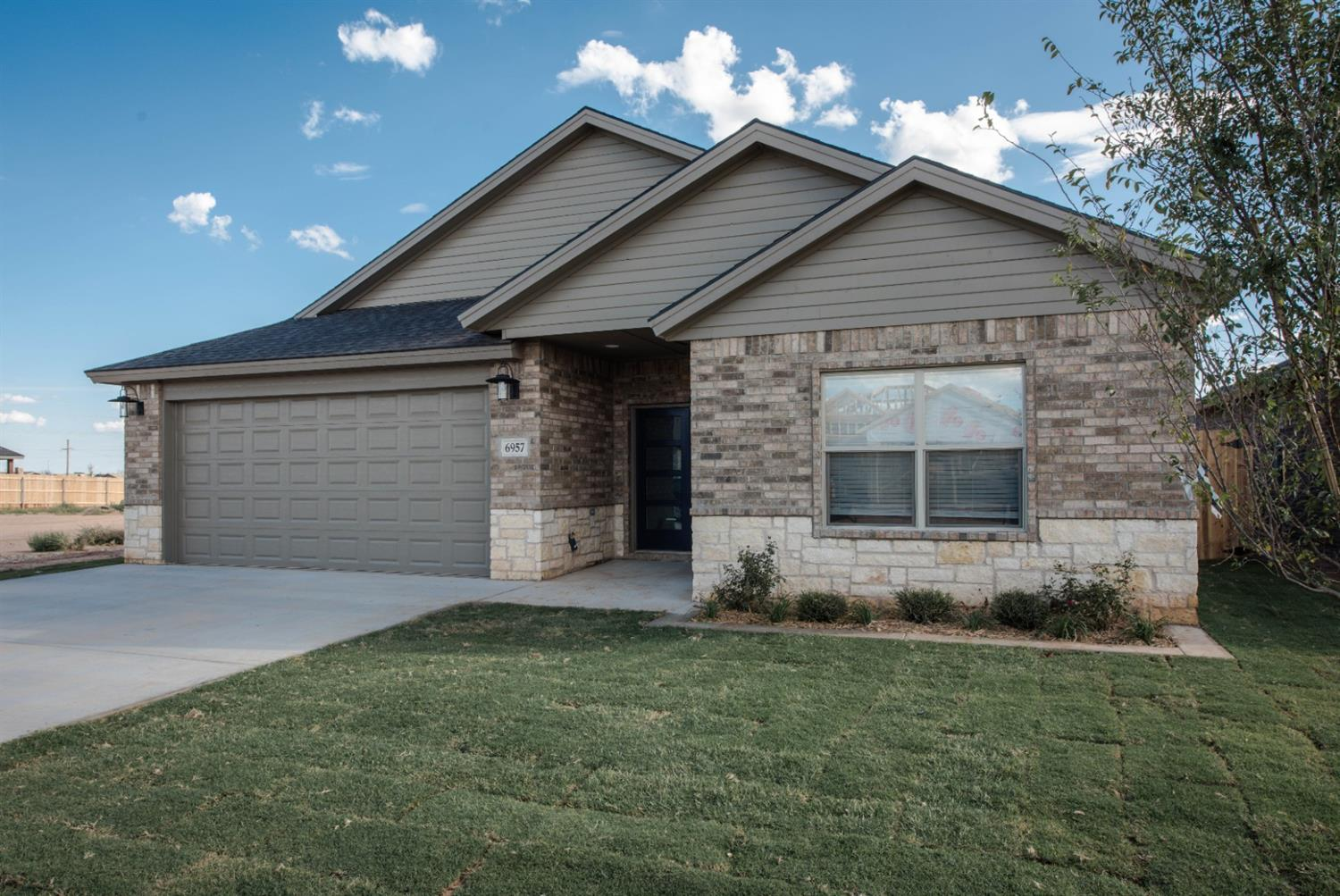 This newly constructed 3 bedroom 2 bath house by Paramount Homes is located in the growing Bushland Springs subdivision in West Lubbock. This home features an open floor plan with tile throughout, a large kitchen and island, and an isolated master suite. Paramount Homes prides itself on quality construction techniques and top-notch customer service. Give us a call today to see this beautiful home that you're sure to fall in love with.