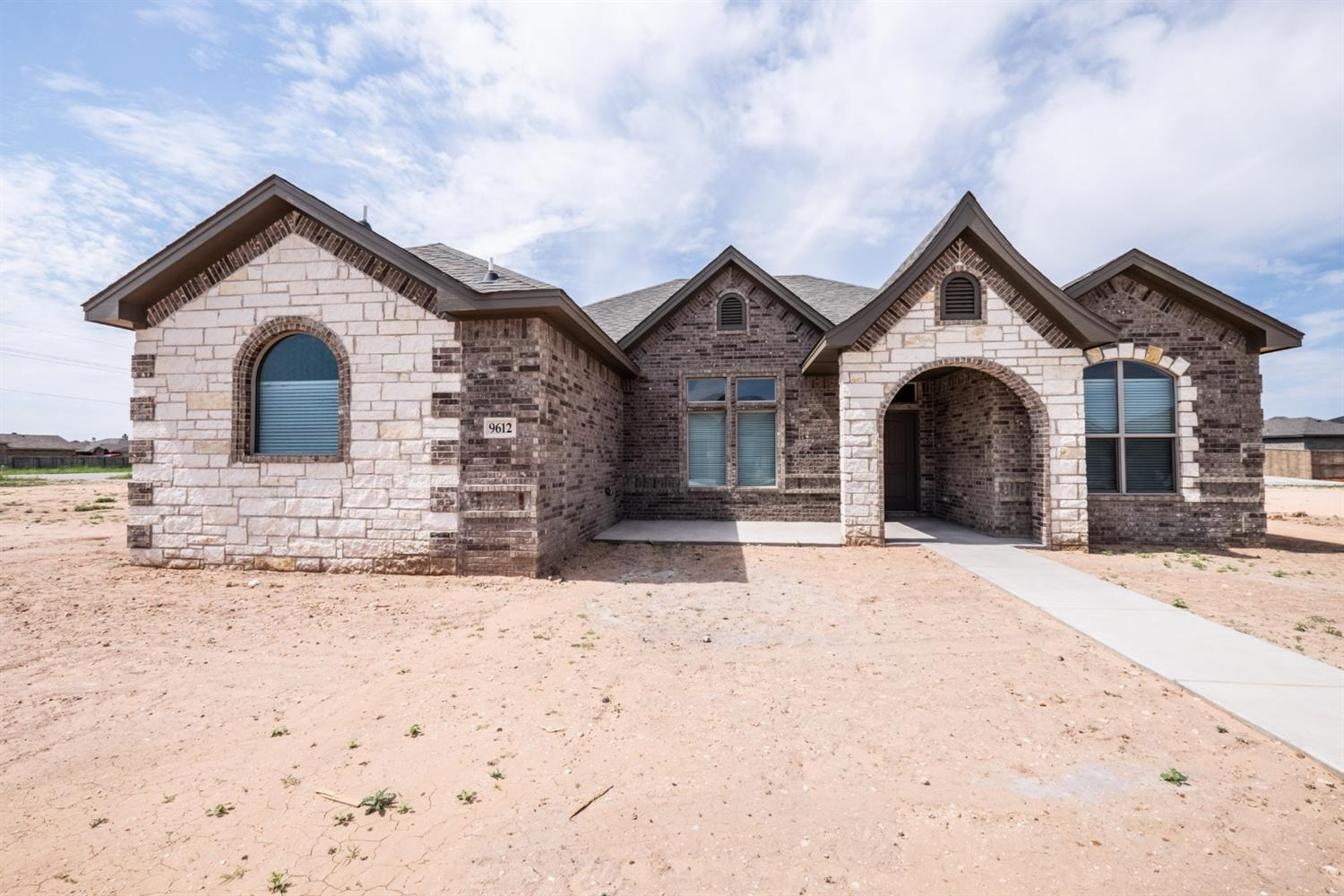 New construction 4 bedroom, 3 bathroom, and 2-car garage (rear entry) home in Day Estates neighborhood. Built for comfort and style, this beautiful brick and stone home has an open concept with 10' ceilings throughout entire house. Located in Frienship ISD, making it a great location! Special features include: double ovens in kitchen, electric fireplace with oak mantle, granite countertops throughout, walk-in closet in Master bedroom, a jet tub in master bath, and vinyl plank flooring in living room and kitchen.