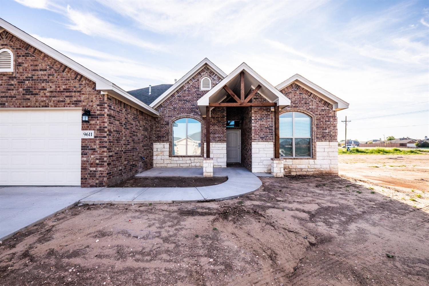 New construction 4 bedroom (1 guest-suite), 3 bathroom, and 2-car garage home in Day Estates neighborhood. Built for comfort and style, this beautiful brick and stone home has an open concept with 10' ceilings throughout entire house. Located in Frienship ISD, making it a great location! Special features include: double ovens in kitchen, electric fireplace with oak mantle, granite countertops throughout, walk-in closet in master bedroom, a jet tub in master bath, and vinyl plank flooring in living room and kitchen.