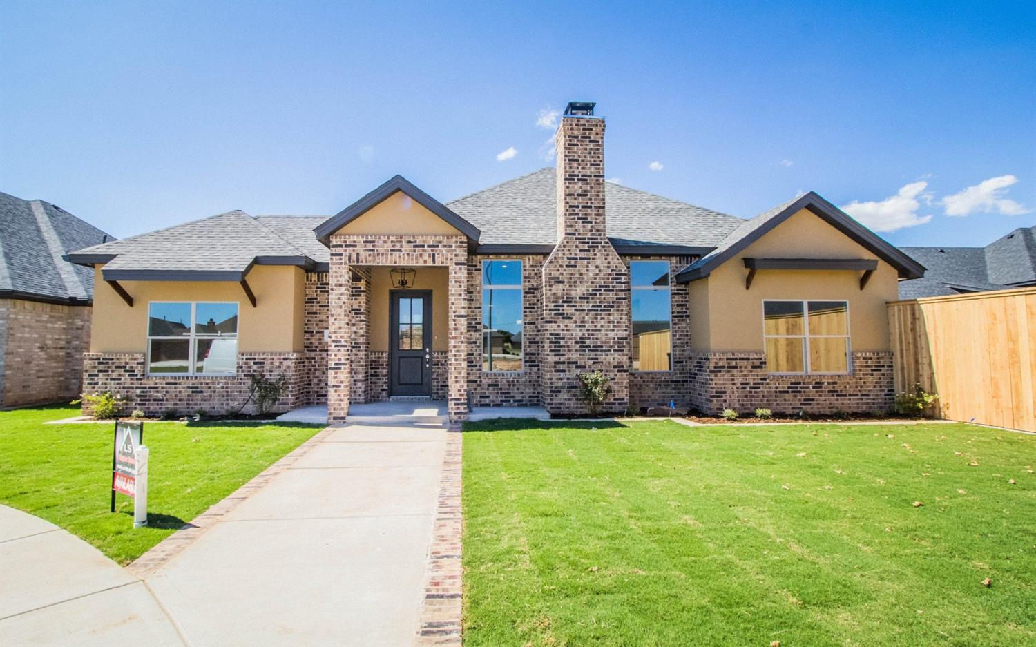 NOW COMPLETE! This beautiful 4/3/3 LS Kingdom Homes garden home is now finished and ready for it's new owner!  The elegant entry way and living area invite you in with stylish herringbone patterned floors and an open concept leading to the beautiful designer kitchen featuring granite countertops and all stainless steel appliances.  Get ready to entertain as large windows surround you letting in welcomed natural light and allow for views to the oversized covered back patio from the entry, kitchen and living areas.  The master bedroom is to die for with a vaulted ceiling and wood beam accent.  The master bathroom impresses with a double vanity, counter to ceiling tile backsplash and polished gold hardware! The large master closet will not disappoint either with lots of space and built-ins for storage.  Guest bedrooms are a great size and both guest bathrooms continue to shine with designer tile showers and beautiful natural stone counter tops. Rear entry 3-car garage. Come see it today!