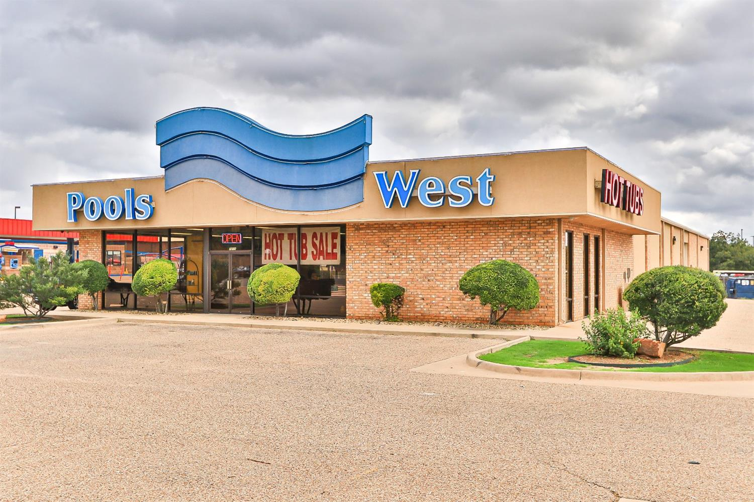 Prime retail location in free standing building. High traffic counts. Building is mostly open and could be transformed for many uses. Pools West is re-locating not going out of business.   Versatile Flex Building For Sale or Lease  High Traffic Counts of 32,000 VPD  Easy Access to S Loop 289  Delivery Dock with Overhead Door Along with 2 Grade Level Doors  Prime Location with Excellent Visibility