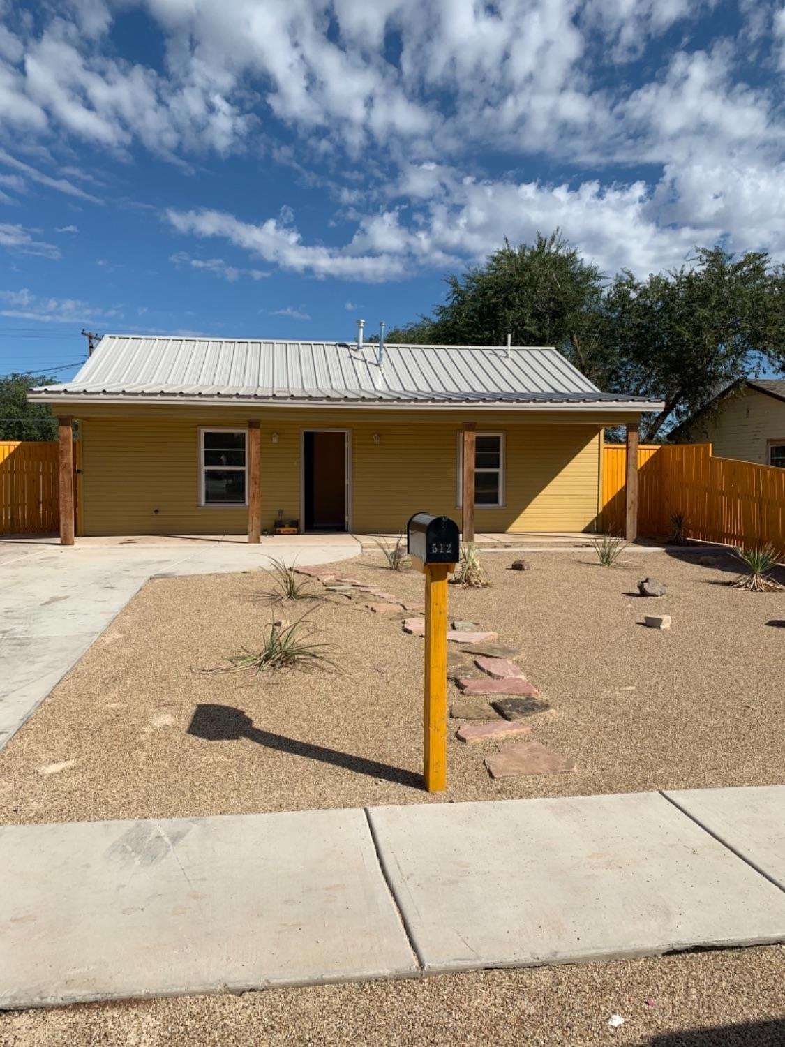 Wow! Take a look at this new build. That's right i said new. This house has an open floor plan, You will love the convenience of stained cement flooring. It has high vaulted ceilings, custom kitchen cabinets. Your insurance will love the new metal roof. The front yard is a zero scape. Enough concrete to accommodate pull behind trailers.There is too much to try to list. come take a look