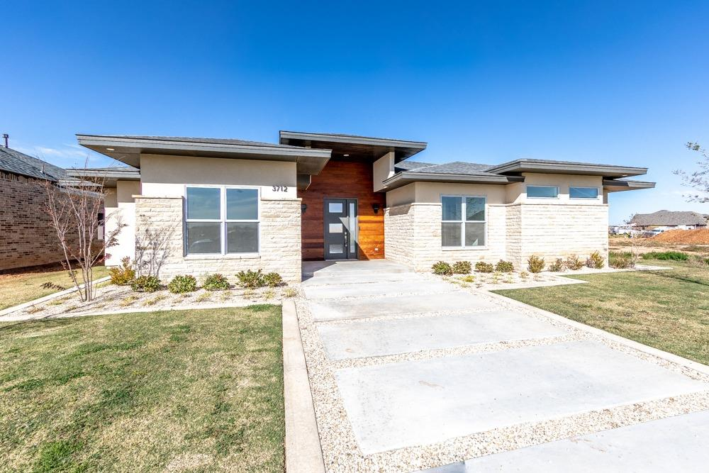 Beautiful & unique home built by Anderson Fine Homes located in Hatton Place.  This home looks like something out of Architectural Digest!  You walk in to a very open concept with 12 foot soaring ceilings.  The kitchen is an entertainers's dream all open to the living area.  Leather granite counter tops, side by side refrigerator & freezer, 5 gas burner cook top.  Living area looks out of glass windows across back.  Surround sound. Outdoor kitchen continues for entertainment.  Master bedroom has access to back patio for morning coffee.  Huge master bath area. Master closet is every woman's dream. This home will not disappoint!  Please come and see this architecture gem.