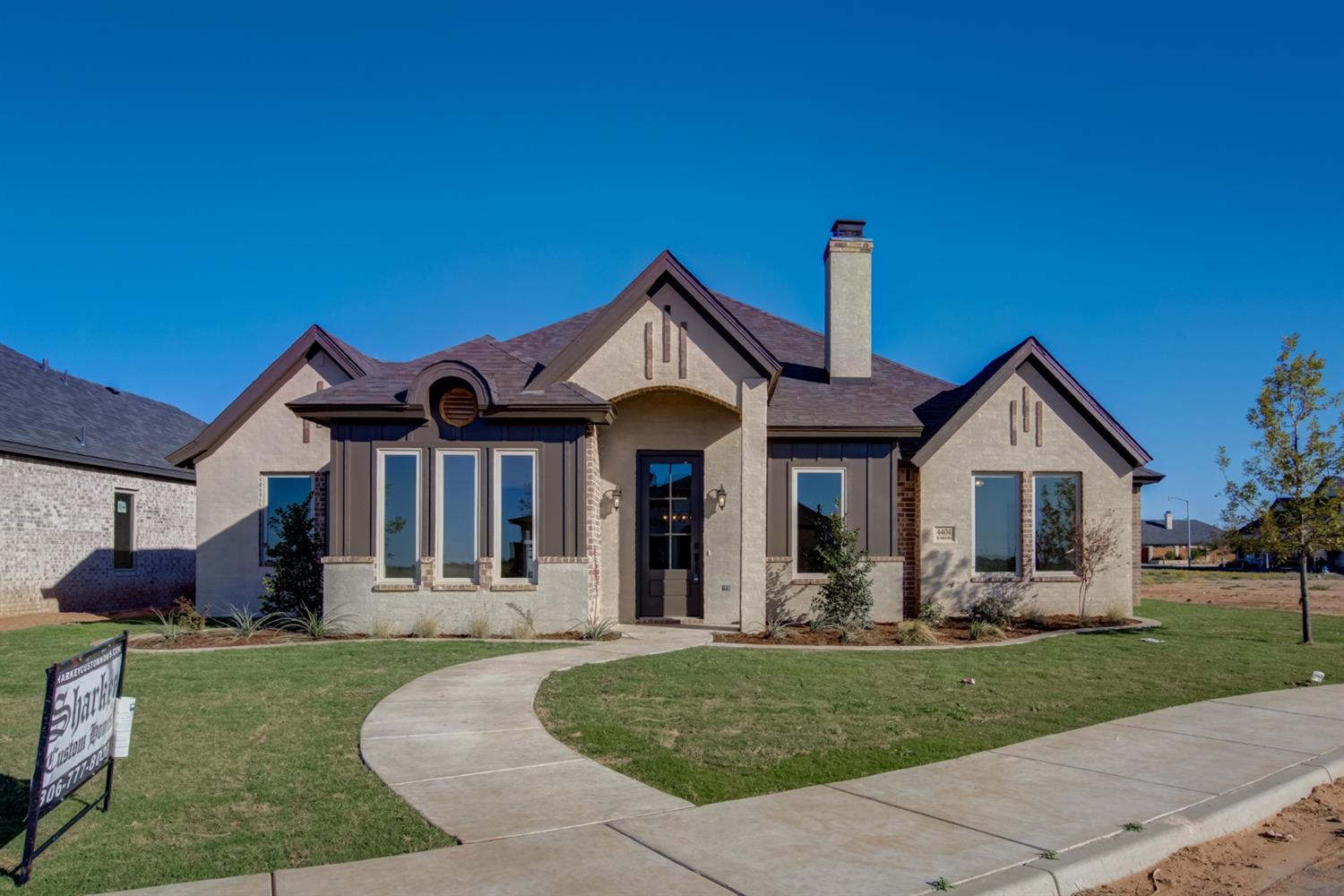 This beautiful Sharkey Custom Homes, Inc. is uniquely designed by Madisson Sharkey.  Her debut property is magnificent! You will love the attention to detail on the exterior of the house. With the combination of brick, wood and smear, it has a unique look all it's own.  As you walk in, you immediately notice the beautiful ceilings, tiled fireplace and gorgeous chef-inspired kitchen! This house has a versatile extra room that can be used as an office or play room. And the laundry room has an area that can be used as a desk or craft area! This is a MUST see!  Call me today for a personal tour!