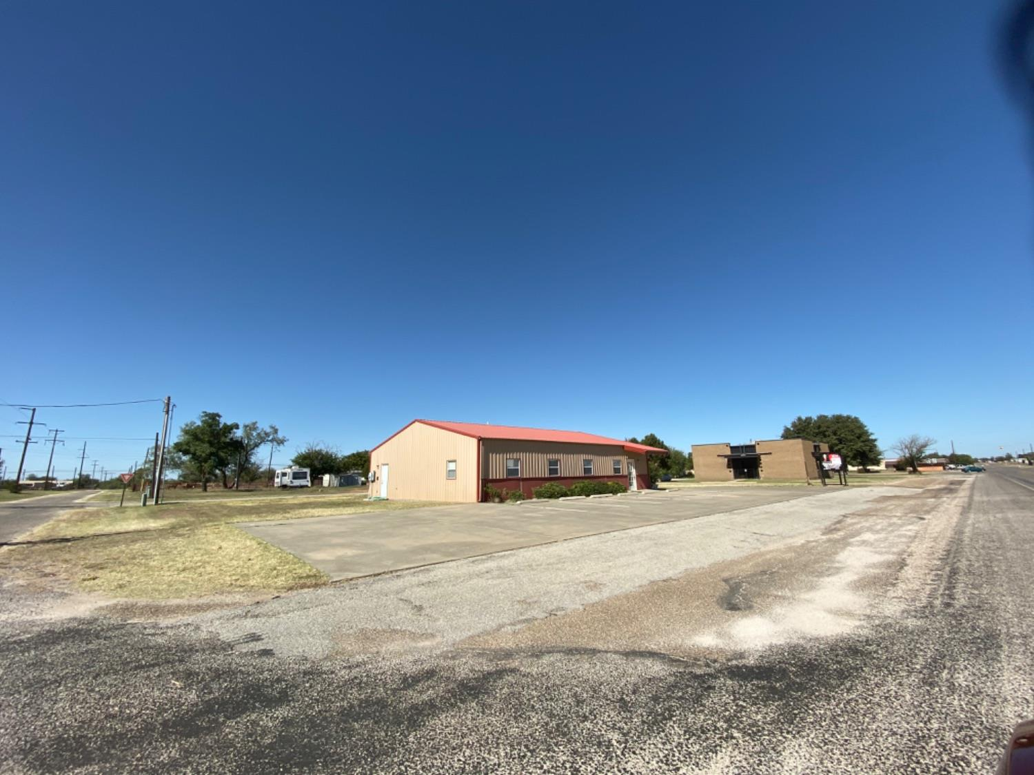 Office building on Main St in Jayton, TX. The building is partitioned into eight offices, reception/common area, breakroom, storage  room, and two restrooms. Option to lease is available with lease at $1800/month.
