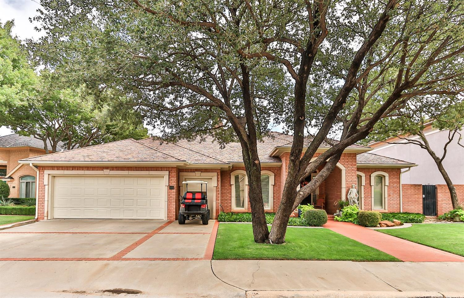 Life is good in this gated/secure neighborhood. 3/4/2 with golf cart garage. Patio/ pool views from all living areas.This is a beautiful neighborhood. Saltwater pool overlooks golf course.  Updated with hardwood floors, new lifetime roof.  Single story, established Lakeridge country club.