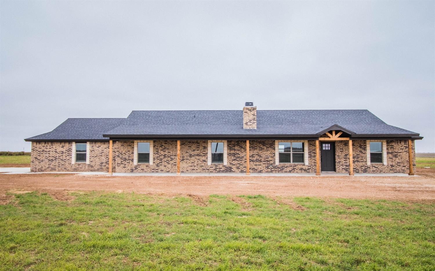 This gorgeous new construction home on 10 acres has it all! The open concept living room and kitchen are complete with a bricked fireplace and vaulted ceilings. Escape to the isolated master that features a large wrap around closet, oversized walk in shower, and double vanities. The large laundry room includes extra storage space and room for a fridge. Relax and enjoy the wide open spaces on the oversized covered back patio.