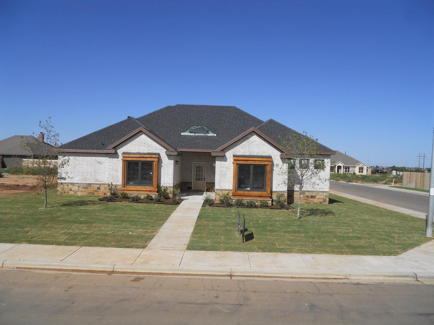 Wonderful Steve Hill Home with unique floorplan and many customs! Great Character with large vaulted ceiling living room with fireplace, open kitchen with walk through dining area with built-in cabinets, kitchen with island and custom wood ceilings and beams, separate 4th bedroom, separate master bedroom with cozy office space in entrance, extra living room in back, and much more!