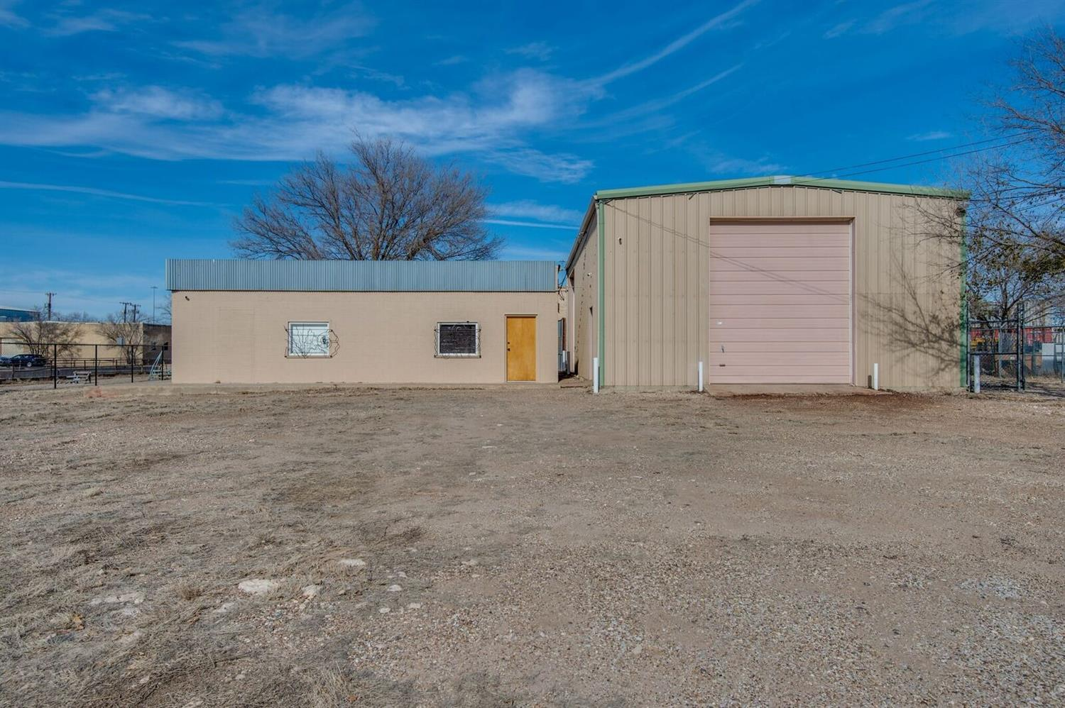 So many opportunities and unique details with this almost half acre property. Every artist's dream, even used to be featured each 1st Friday Art Trail! Really great warehouse in downtown Lubbock featuring a detached studio with 1 large bedroom, huge closet room, 1 bathroom, a kitchen and laundry space. Property is just under half an acre. Metal fence with electric access gate. Studio has new cabinets, track lights, blinds and new appliances.  2095 SF warehouse has two storerooms with storage above them and two garage doors - one is electric and the other is chain hoist. Features heat sensors connected to alarms in both buildings. Skylights in the warehouse replaced and the roof 80% replaced in 2014. The metal roof on the studio had rubberized coating added in 2015. Security system with 8 cameras, low light recorder, motion detection and separate security panels for each building included.