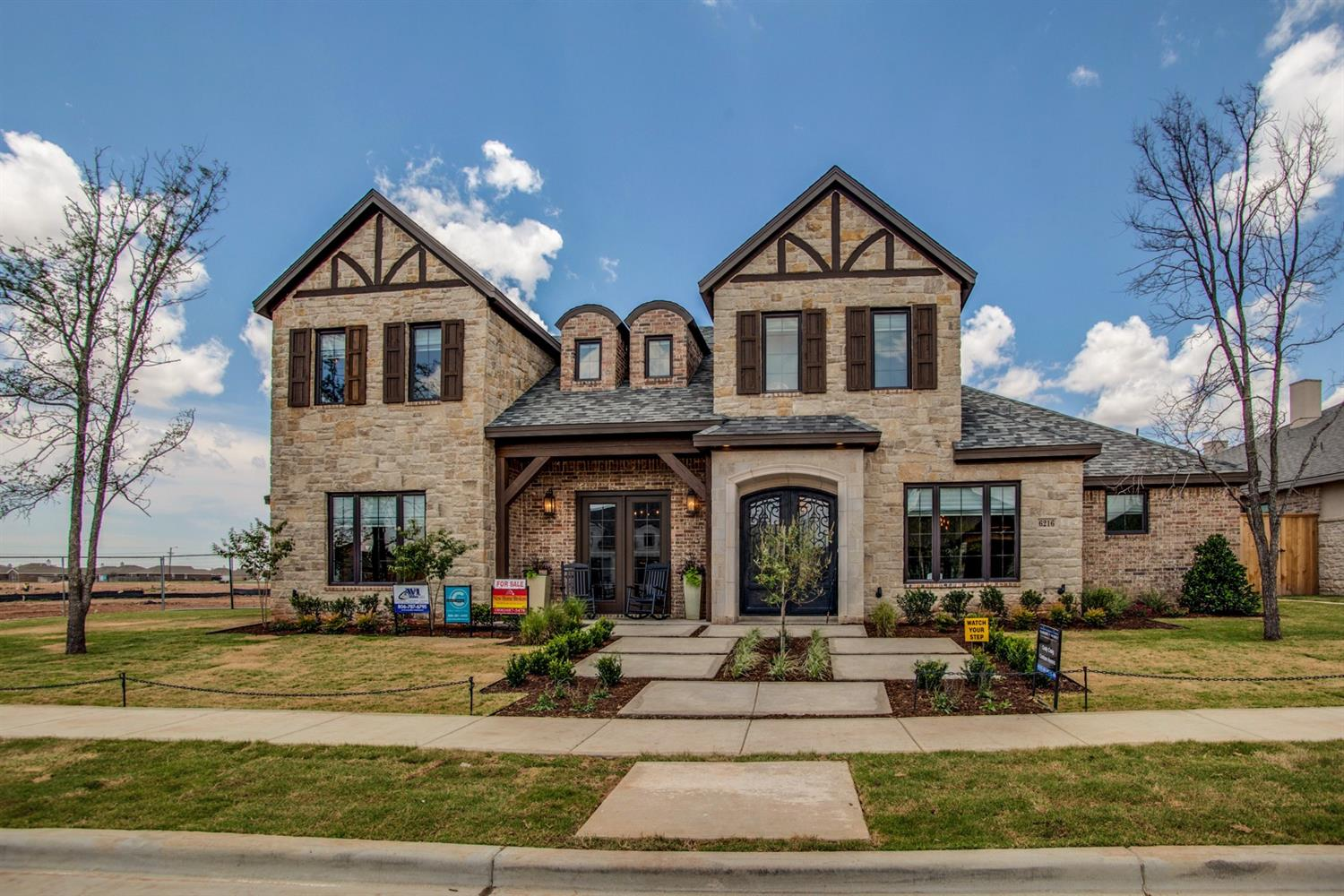 This stunning home in The Trails at Regal Park won Best Interior as a Parade Home in 2016. Beautiful curb appeal as you walk up to this brick and stone home with gorgeous cedar accents.  Walk in to an open concept floor plan with light oak hardwood floors. The perfect amount of rustic touches throughout including repurposed barn wood used for the ceiling and an accent wall. The open living and kitchen area has beautiful natural light with sliding doors that lead into this fabulous backyard.  The oversized island makes the perfect gatherin place.  This home has the space you need for a family with four bedrooms, three bathrooms, a formal dining room, study and an upstairs bonus area that would make a great game or play room.  Complete with a mud room, safe room, big covered patio with built-in grill, garden area in corner of yard, and lots of entertaining space! Welcome home!