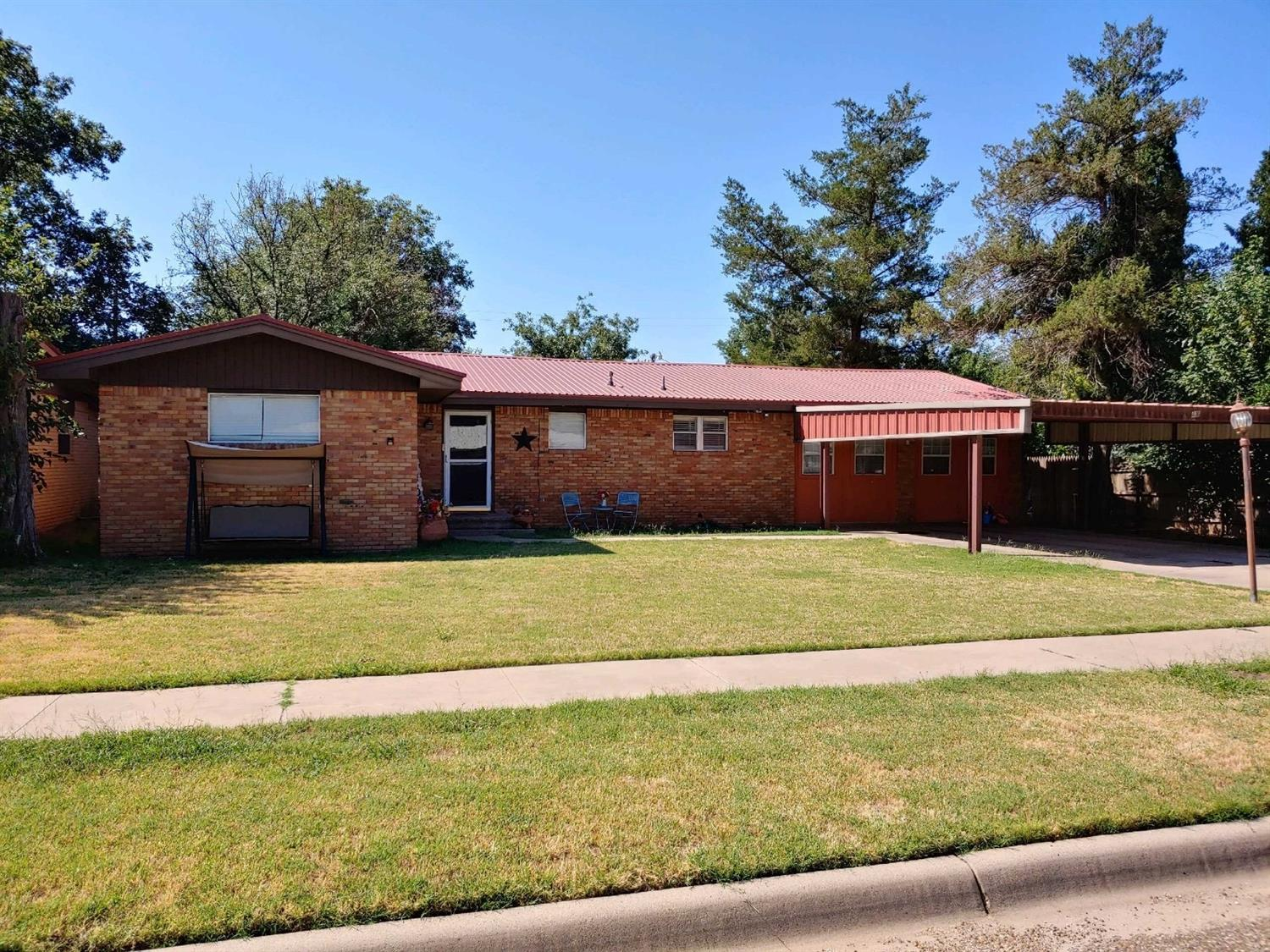 Check out this great 3/2 house in Littlefield with a 2 car Carport. You do not  want to miss seeing this home. Large Rooms, bathrooms remodeled, excellent storage and much more.