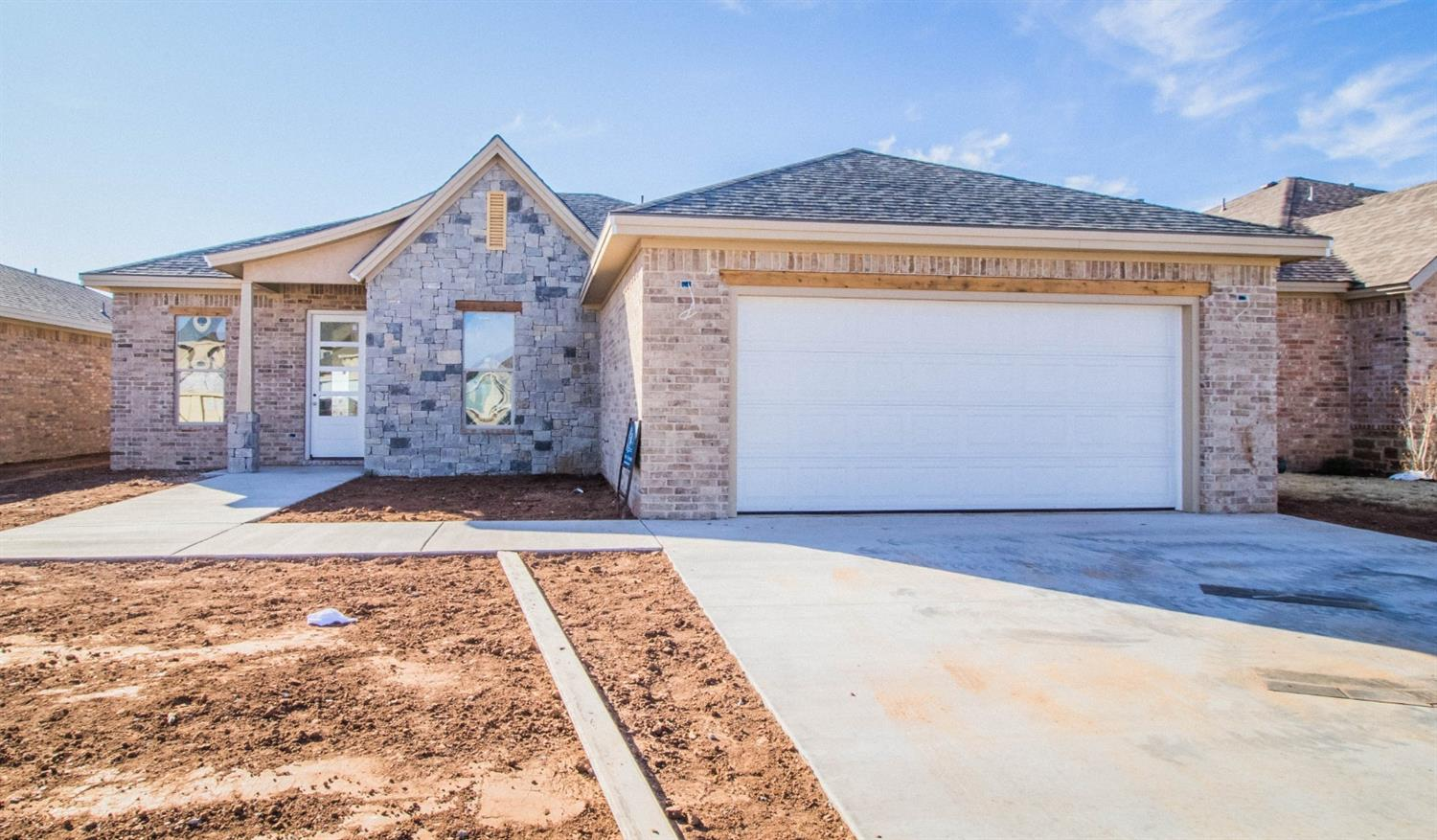Check out this Amazing Kim Craig Home. This 3/2/2  with an office is stunning. The floor plan is fun and has a great flow. Stone Wood is a new development that has front entry garages and is a great up and coming neighborhood.