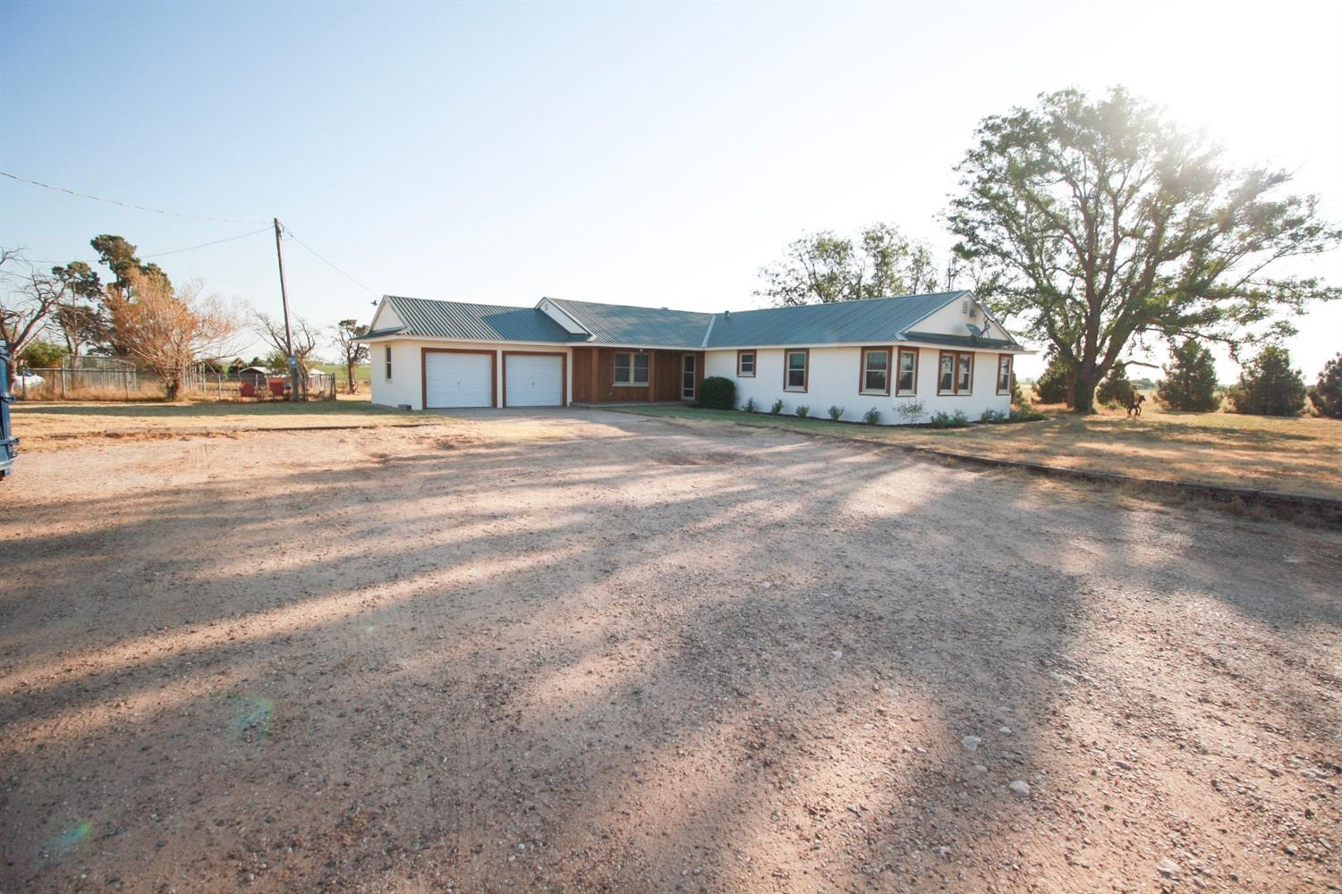 Adorable farmhouse on approx. 11 acres in Lubbock Cooper School District!  4/2/2 with updated master bath, guest bath, kitchen counter-tops, tile back-splash, sink, new dishwasher, metal roof, hardwood floors just refinished, double pane windows, well pump & bladder replaced 4/19 & AC unit was replaced in 2016.  2 barns for stock-show animals & livestock.  All of the pens & panels will convey!  A little piece of paradise...You have to see for yourself, photos just do not do it justice!