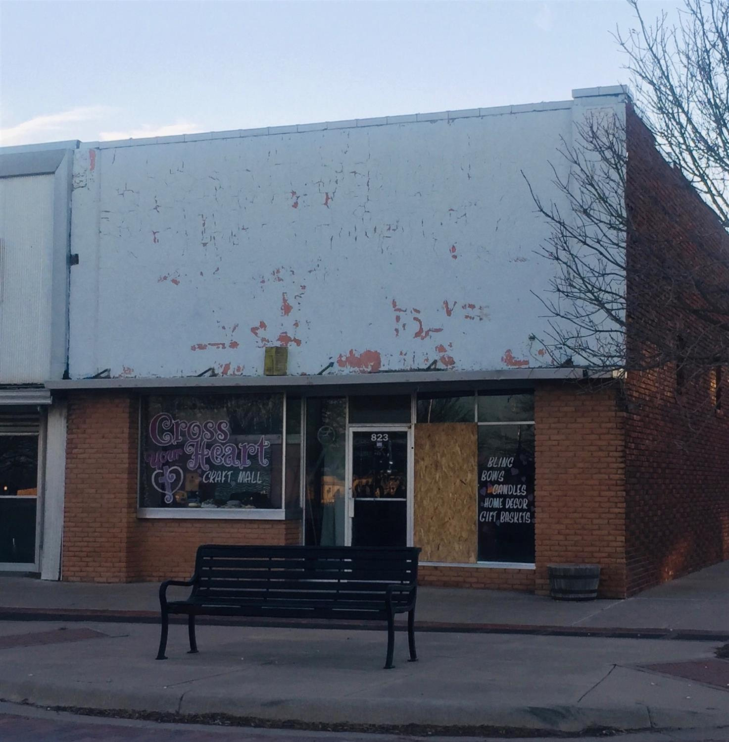 The possibilities are endless with this gorgeous vintage space in the heart of downtown Ralls! Previously a sandwich shop, a floral boutique and a craft mall, this building can be whatever you need. You'll find storage upstairs or a fantastic second workspace  it depends on your vision!