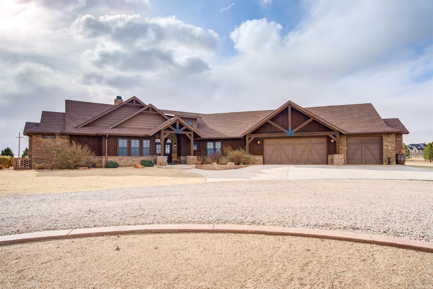 Shallowater Country Estate complete with all the amenities you can imagine. Beautiful Rustic Modern Ranch design sitting on 22 acres and loaded with amazing beam & truss features complemented by beautiful ledge rock. Woodwork detail is amazing in this open plan with 4 bedrooms, 4 bath, basement, office, and a supersized 3 car garage. The master retreat will not disappoint and the views form all rooms are spectacular. Step outdoors to the amazing patios and enjoy the West Texas sunsets. The entire acreage is fenced w/ pipe and cable. The barn/shop is designed w/plenty of storage for equipment, 2 overhead doors, large work space and access for working animals in the adjacent pens. As a bonus it has an apartment which is air conditioned and has full bath. The garden also hits the mark with a green house, elevated beds, a chicken coop, and a brick pizza oven. If country living and animals is your cup of tea then you have found your paradise and located in the popular Shallowater ISD.