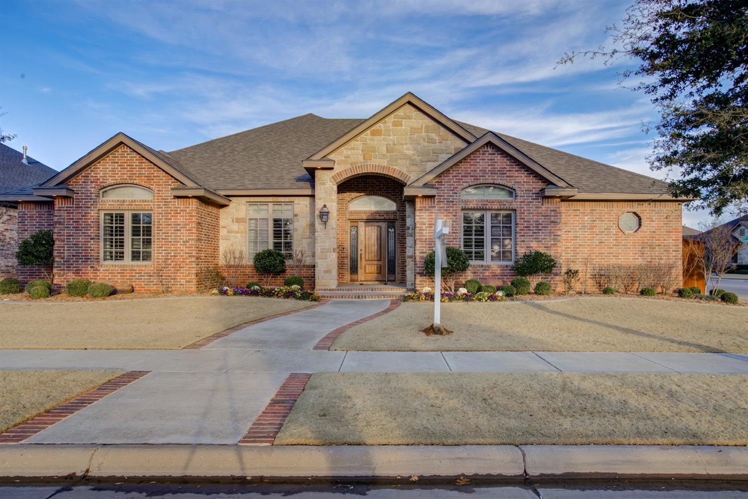 This gorgeous custom home is located in the prestigious Trails At Regal Park.  You can enjoy the beautiful park which is in walking distance. Entering you will be welcomed by hardwood floors and a 15 ft cathedral ceiling which opens up to the kitchen and both eating areas. This home was designed for entertaining. Stone fireplace in living room with custom cabinetry, really makes a statement. Formal dining with 2 archways to enter, casual dining room with wood burning fireplace. Kitchen has stainless steel appliances, including gas stove top, double ovens, microwave, dishwasher and wine fridge. All of this surrounded by lots of custom cabinets and a wrap around breakfast bar. Huge walk in pantry and office nook off the kitchen. Isolated master with separate corner tub, walk in shower and large walk in closet. 2nd isolated bedroom and bath, 4th bedroom with french doors could be great office. Basement for your leisure. Shutters throughout the home. 3 car garage, covered patio,large yard.