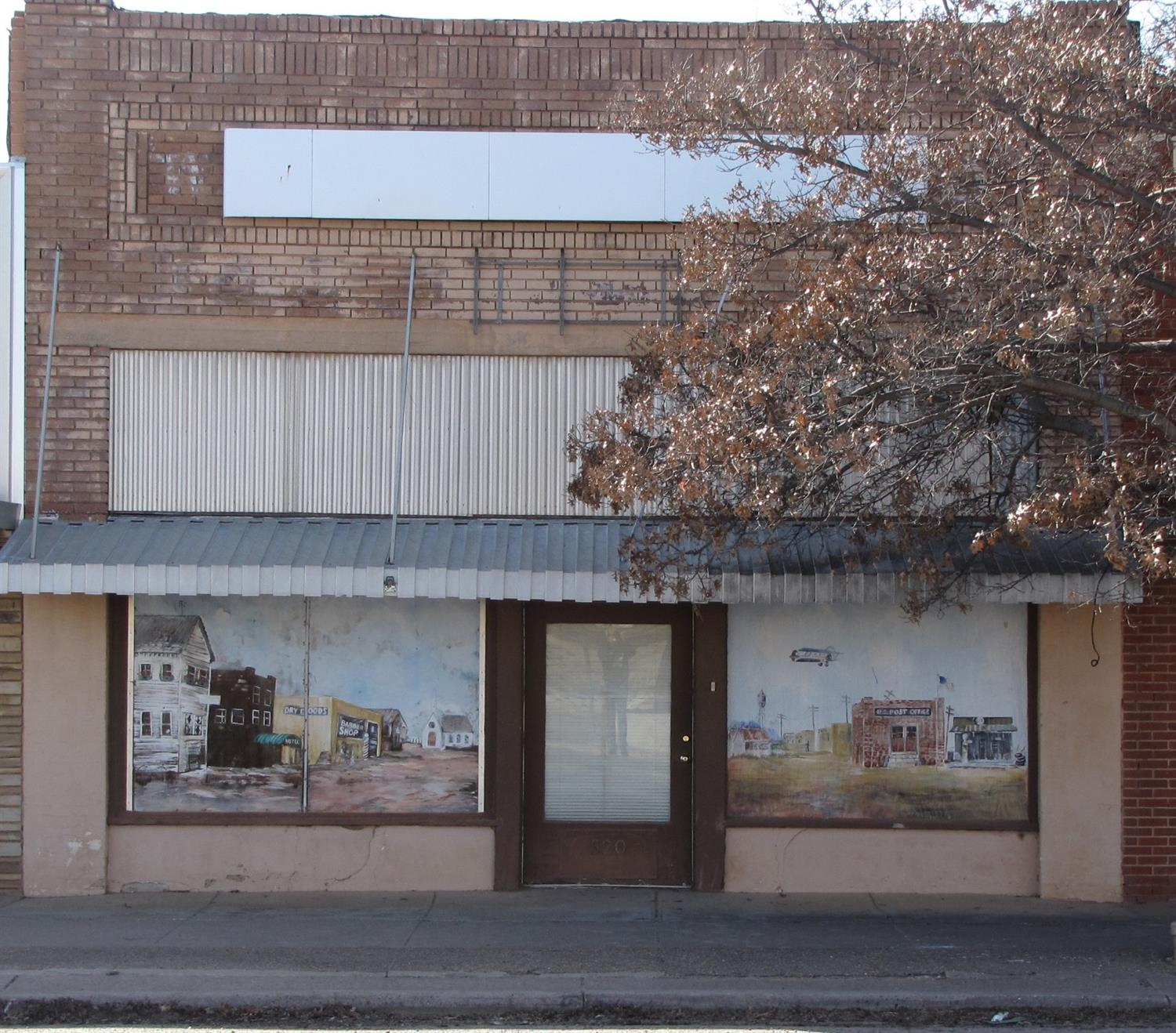 Approximately 2250 square feet of storage/shop/office space in downtown Lorenzo. Separate office at front entrance. Overhead door and walk door at back entrance. Storage area above office. Needs work. Sold as is.