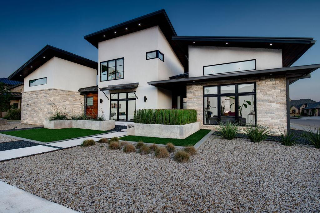 Absolutely stunning modern design with this luxurious home in the Estates at Oakmont. You will fall in love with the sleek finishes like walnut cabinets, tongue and groove wood plank soffit, xeriscaped yard, quartz countertops throughout, commercial grade windows, steam oven & induction cook top. This home is built to feel like you are on vacation every single day with features like a coffee maker in the master suite, Crestron automated electronics system, a large salt water pool with automatic cover & lounge area, an outdoor shower, a workout room overlooking the backyard entertainment space that includes an amazing outdoor kitchen area with over 1,000 square feet of covered patio. The automated sun shades around the patio make it into an outdoor living space that can be used year round. Every feature of this home was meticulously designed to optimize space and functionality so that you enjoy your home and have a stress free lifestyle that allows you to entertain family & friends!