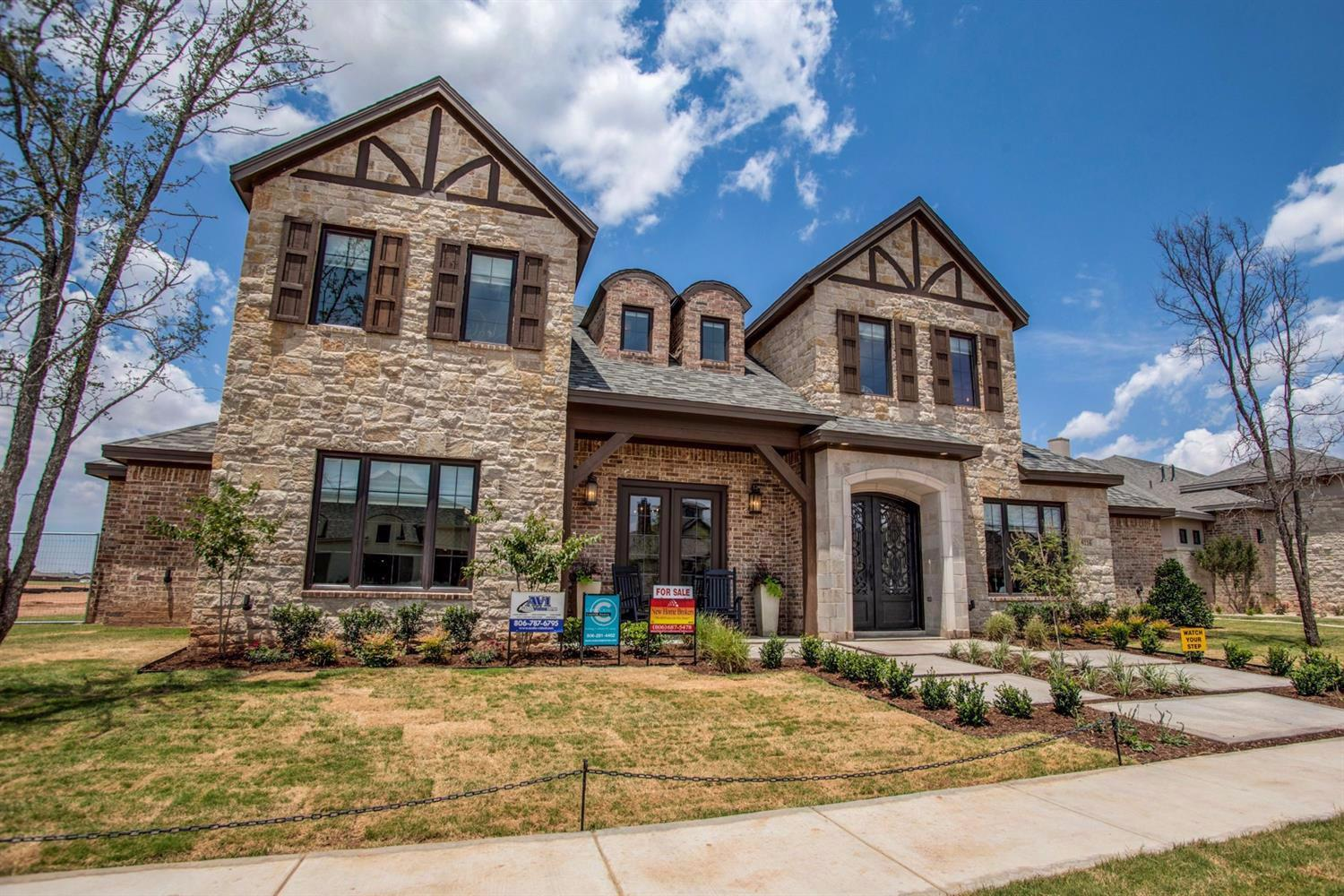 This stunning home in The Trails won Best Interior as a Parade Home in 2016.  Beautiful curb appeal as you walk up to this brick and stone home with gorgeous cedar accents.  Walk in to an open concept floor plan with light oak hardwood floors. The perfect amount of rustic touches throughout including repurposed barn wood used for the ceiling and an accent wall. The open living and kitchen area has beautiful natural light with sliding doors that lead into this fabulous backyard.  The oversized island makes the perfect gatherin place.  This home has the space you need for a family with four bedrooms, three bathrooms, a formal dining room, study and an upstairs bonus area that would make a great game or play room.  Complete with a mud room, safe room, big covered patio with built-in grill, garden area in corner of yard, and lots of entertaining space! Welcome home!