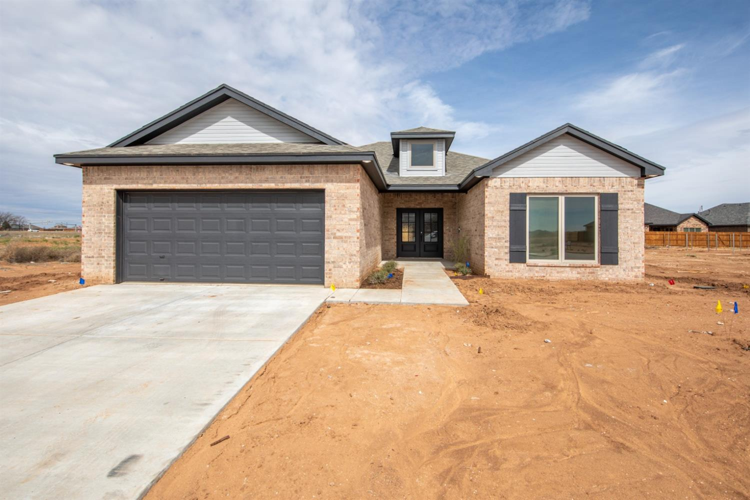 Brand New Construction located in Lubbock-Cooper ISD! Walking into the large double front doors you will be welcomed with luxury wood tile leading you to the spacious living room featuring tall 10' ceilings, beautiful fireplace and tons of natural light. The chefs kitchen is open to the living area great for entertaining, featuring stainless steel appliances, granite counter tops, large walk in pantry, custom built cabinets and tons of storage space.  The Isolated master suite has a tall vaulted ceiling, double sinks, separate shower and tub, 2 large walk in closets! Guest bedrooms have large walk in closets and double sinks in the bathroom. Spray foam insulation and 16 seer AC Unit makes for an energy efficient home!  Outside you will find sprinkler, grass, cedar fence and flower beds with one tree. This home won't last long!